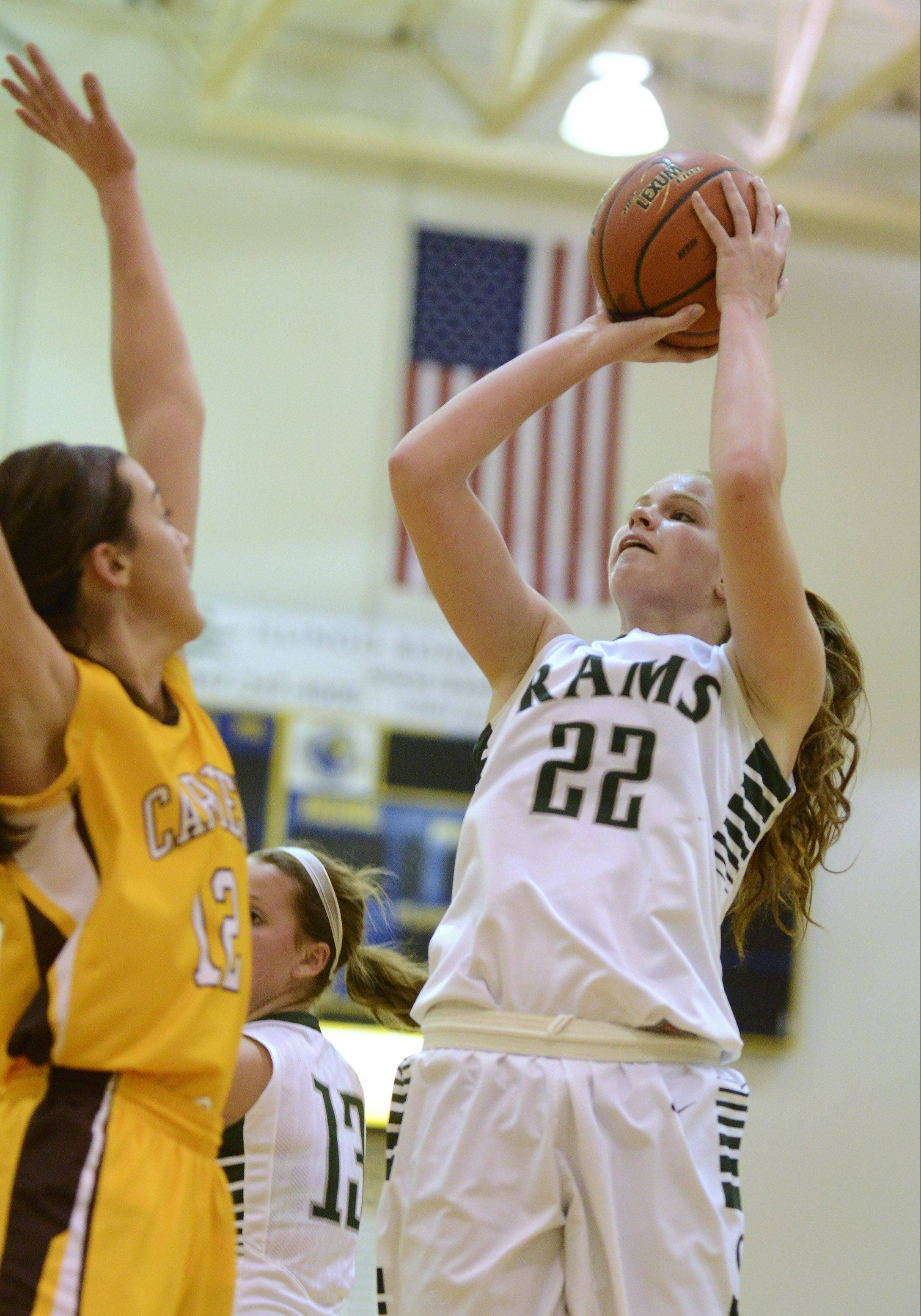 Graylake Central's Morgan Dahlstrom takes a shot in front of Carmel defender Kathleen Felicelli at Warren on Saturday.