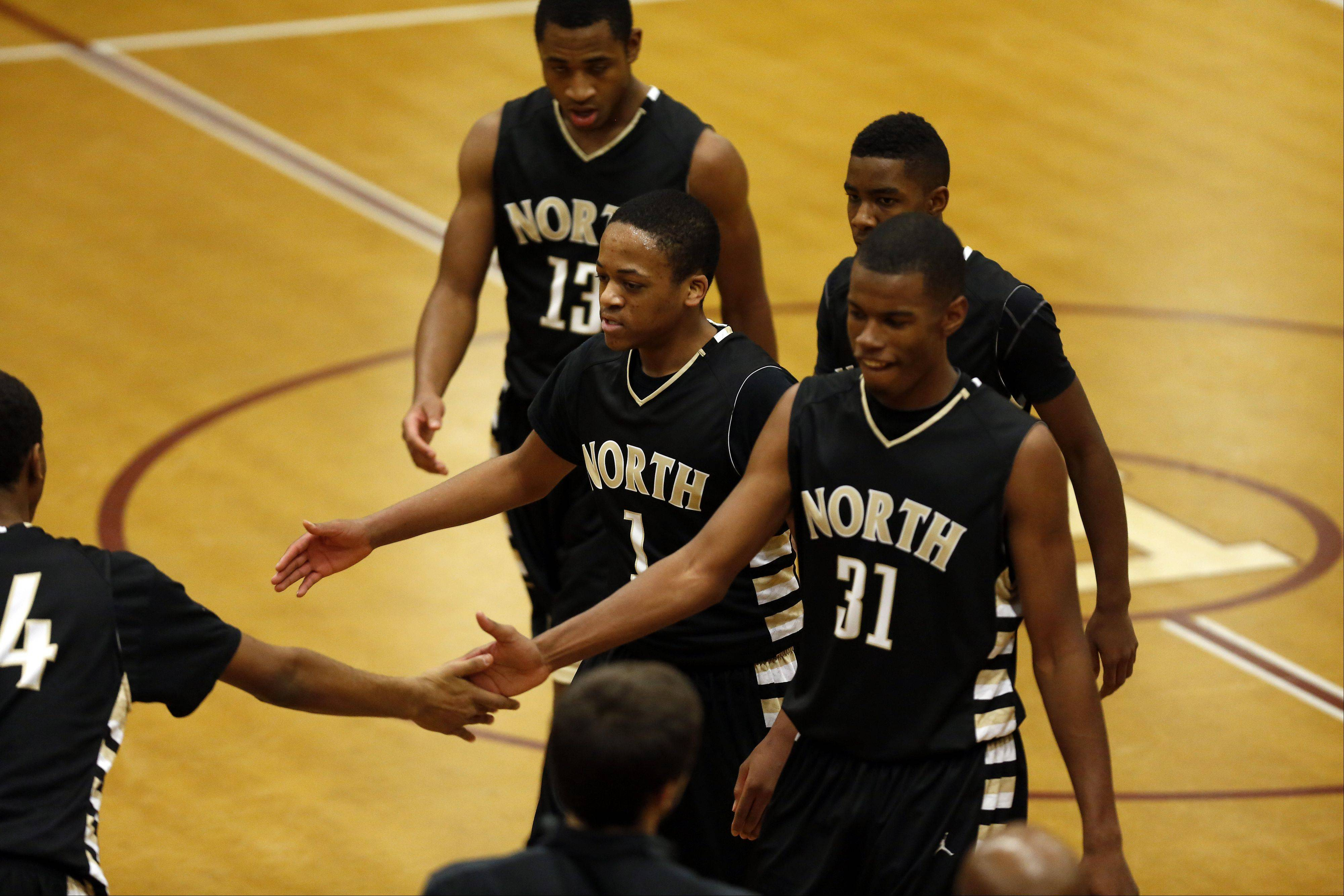 Glenbard North's Jeremiah Fleming, center, and Chip Flanigan, right, leave the court at the end of the third quarter against Elgin at the 39th Annual Elgin Boys Holiday Basketball Tournament at Elgin High School Saturday.