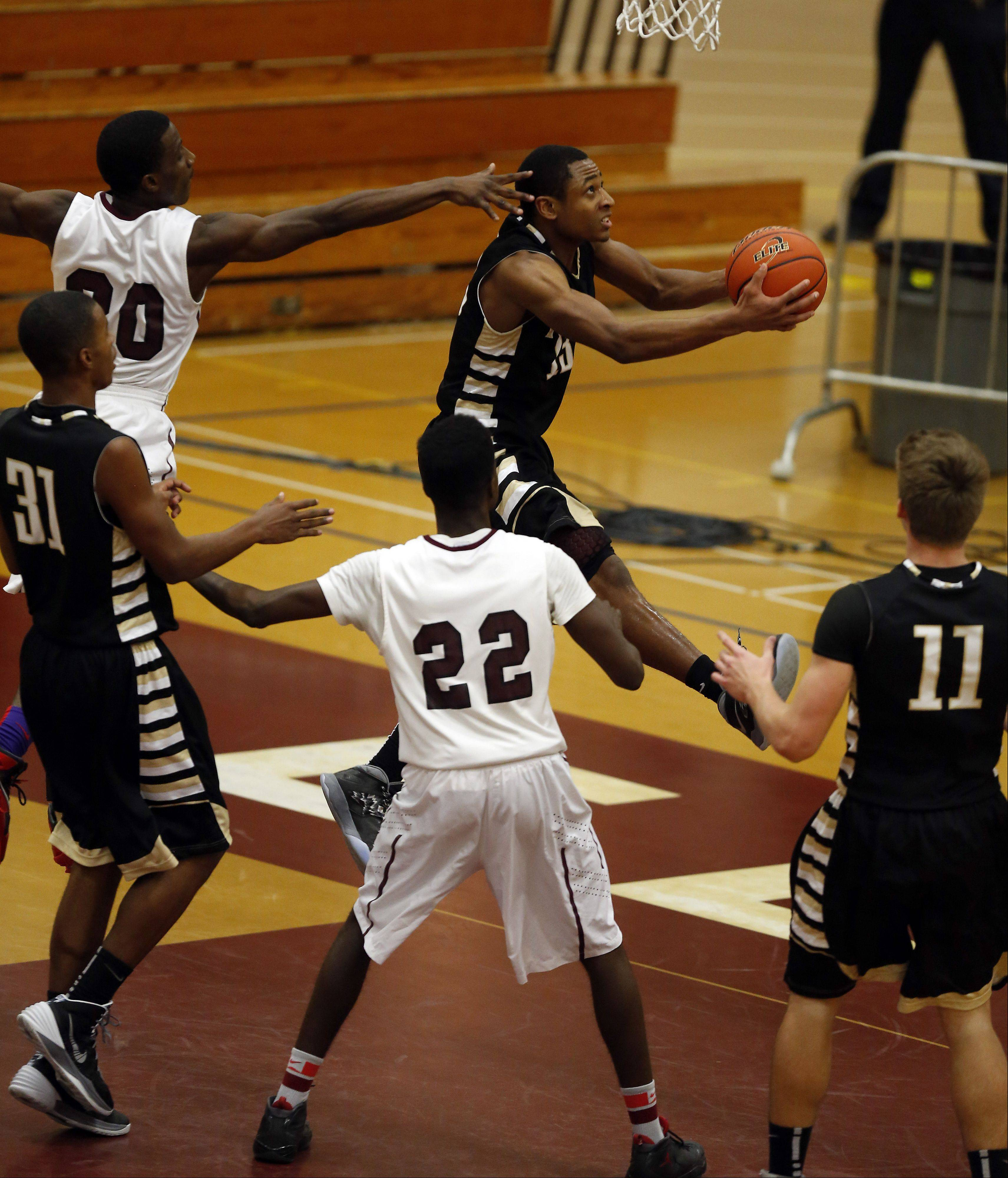 Images from Elgin vs Glenbard North at the 39th Annual Elgin Boys Holiday Basketball Tournament at Elgin High School Saturday December 28, 2013.