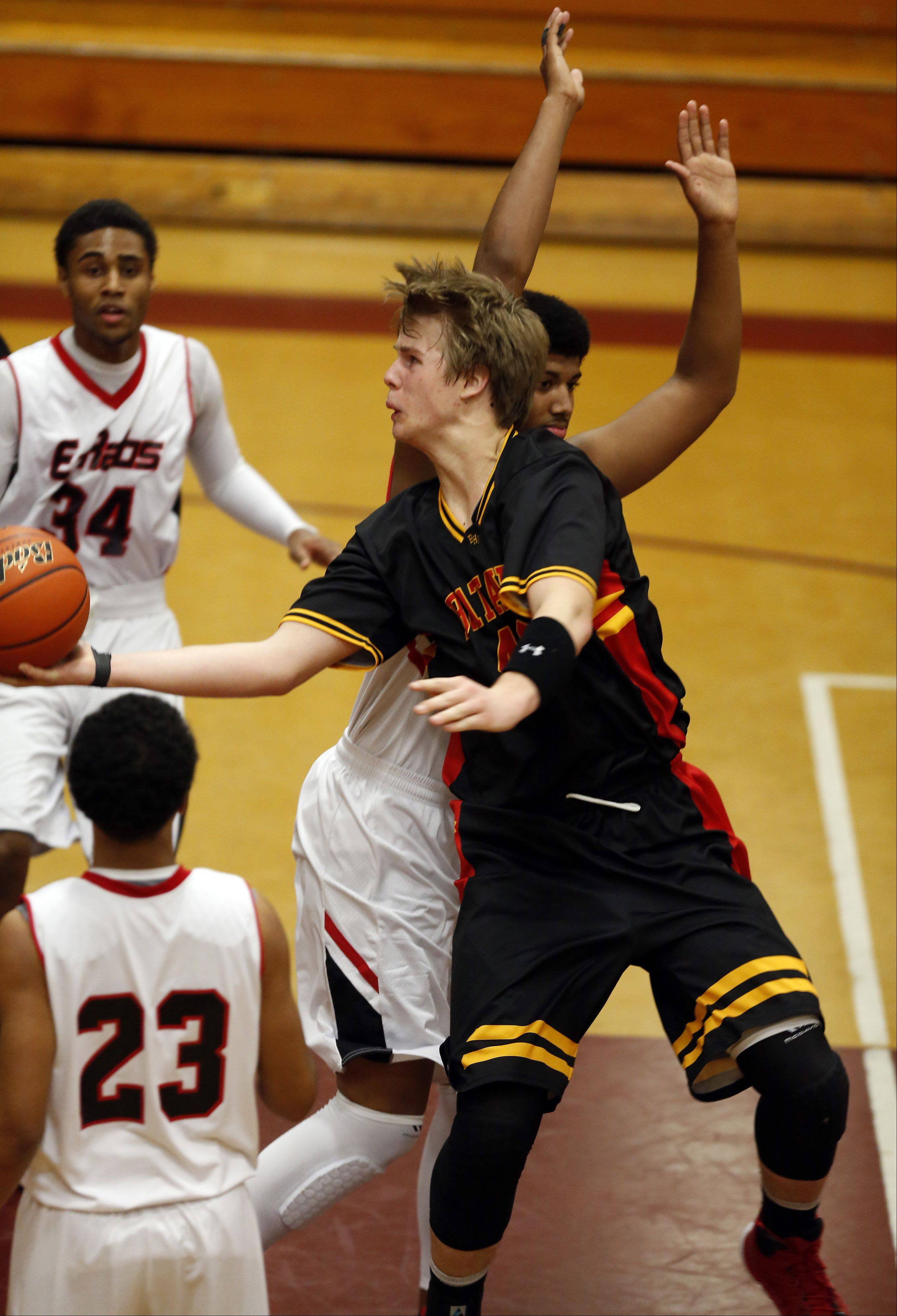 Batavia's Chasen Peez goes strong to the hoop past Rockford East's Bryant Nolan at the 39th Annual Elgin Boys Holiday Basketball Tournament at Elgin High School Saturday December 28, 2013.