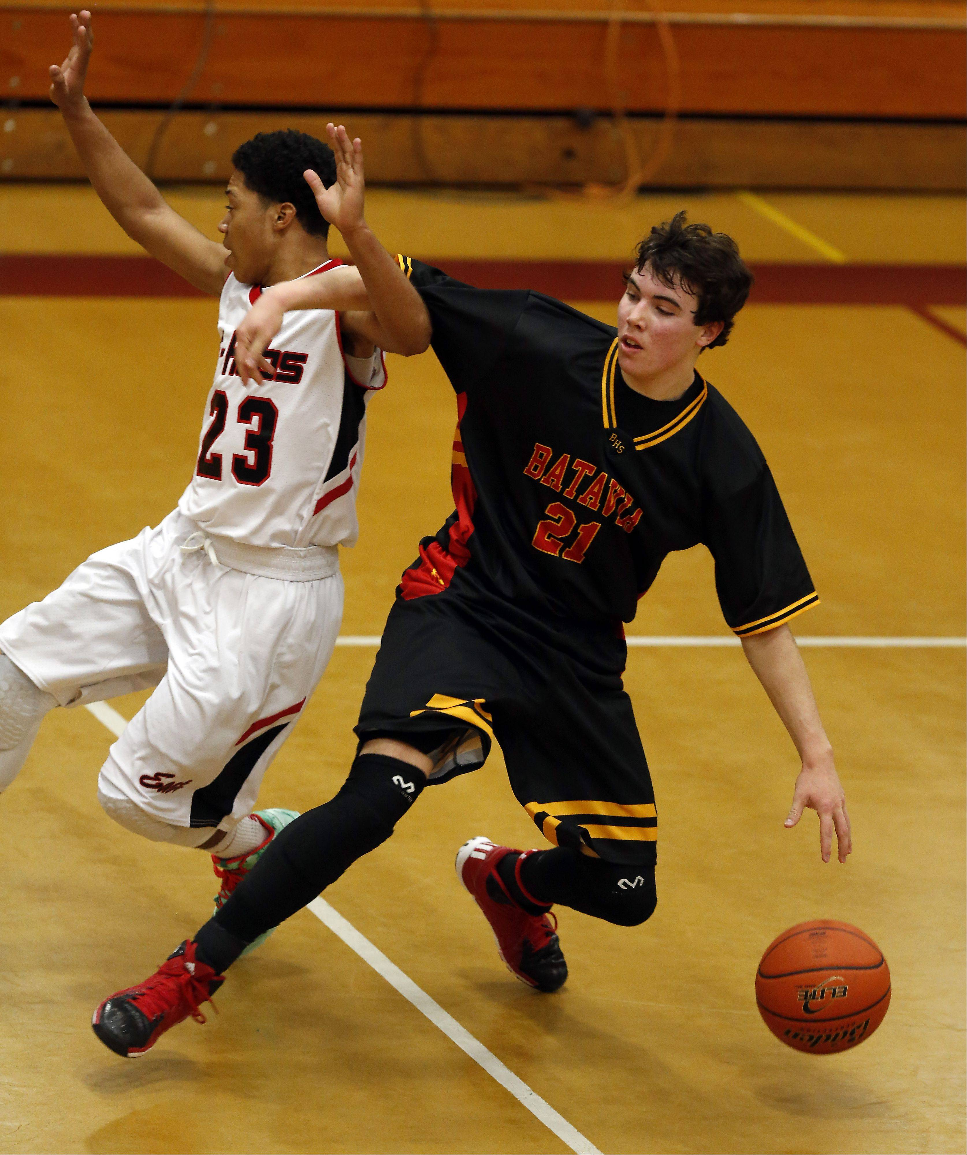 Batavia's Jeremy Schoessling gets tangled up with Rockford East's Daevion Dixon at the 39th Annual Elgin Boys Holiday Basketball Tournament at Elgin High School Saturday December 28, 2013.