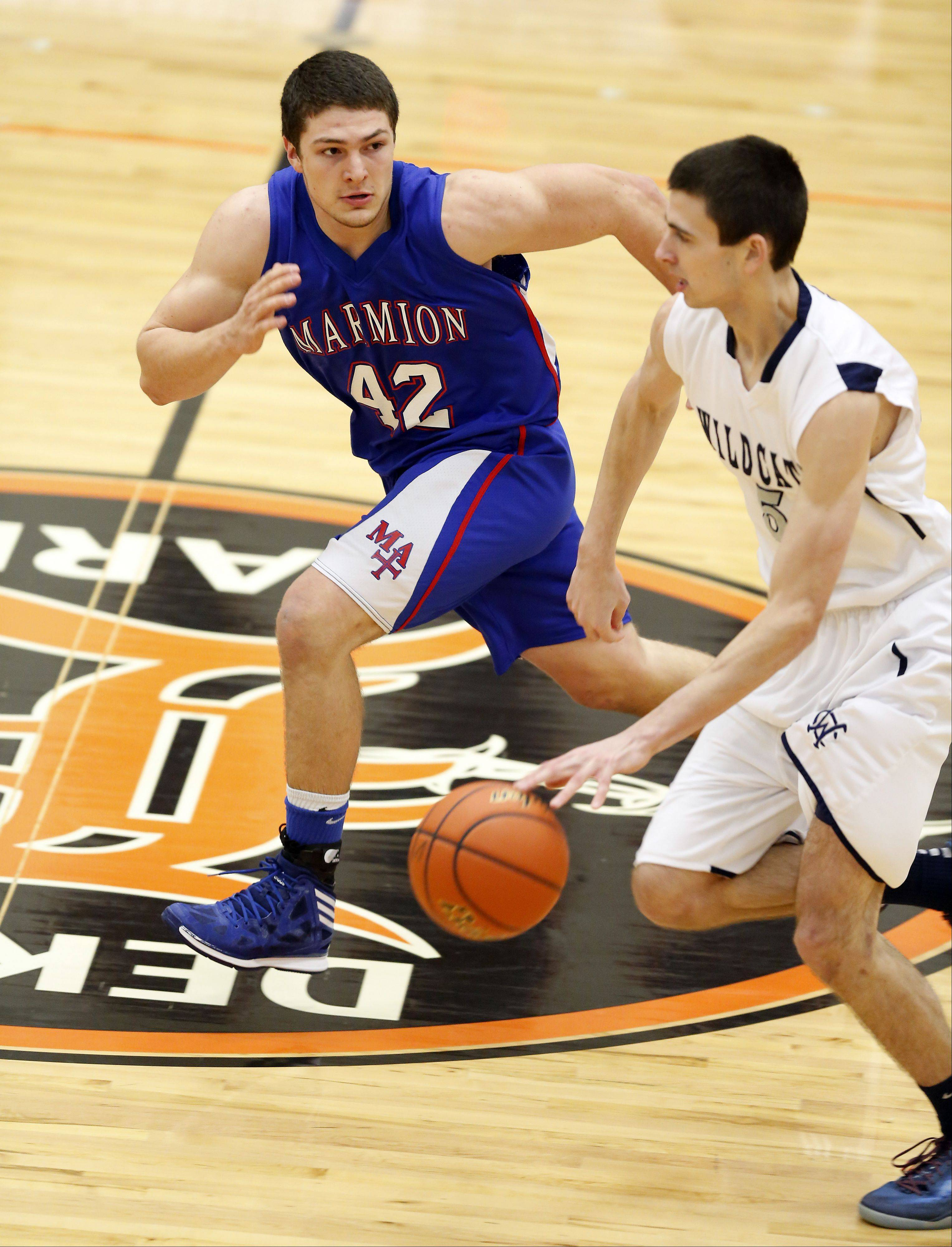 Marmion's Jordan Glasgow, 42, puts some pressure on West Chicago's John Konchar, 5, during the third place game at the 86th Annual Chuck Dayton Holiday Basketball Tournament at Dekalb High School Friday December 27, 2013.