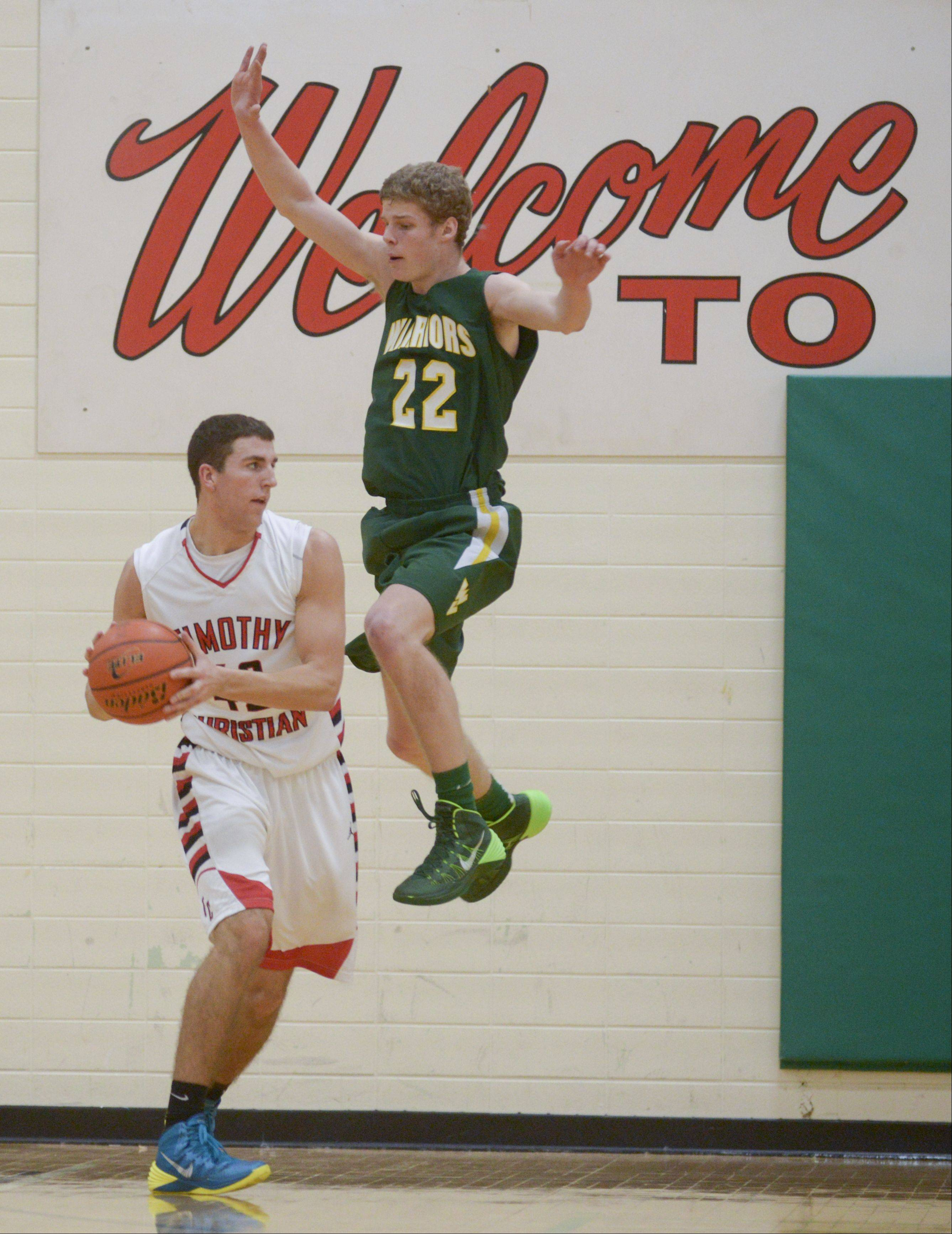 Timothy Christian's Connor VanderBrug looks to pass around Waubonsie Valley's Jack Cordes during the Jack Tosh Holiday Classic at York High School Monday.