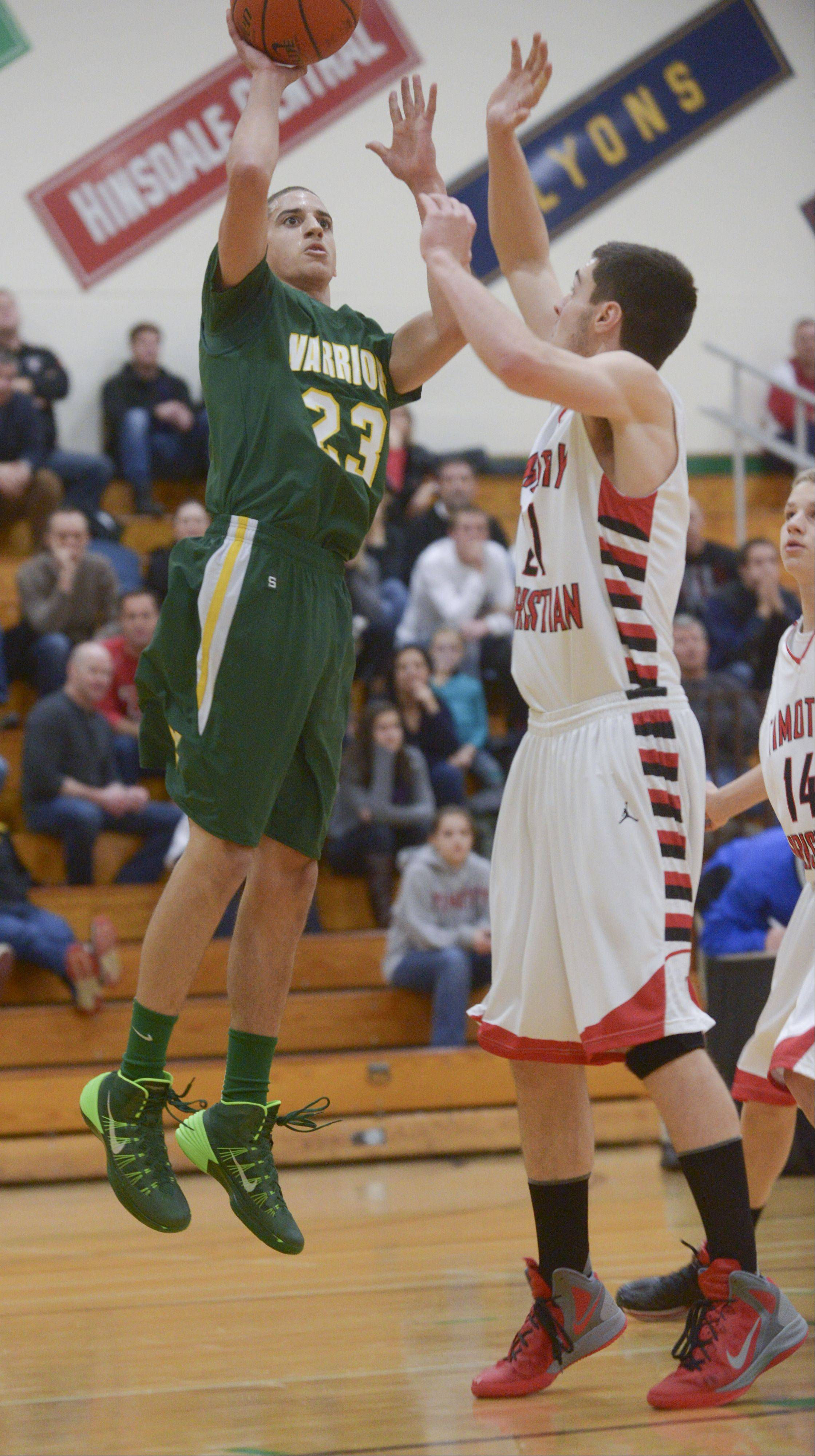 Waubonsie Valley's Jay DeHaan takes a shot over Timothy Christian's Wes Ditchfield during the Jack Tosh Holiday Classic at York High School Monday.