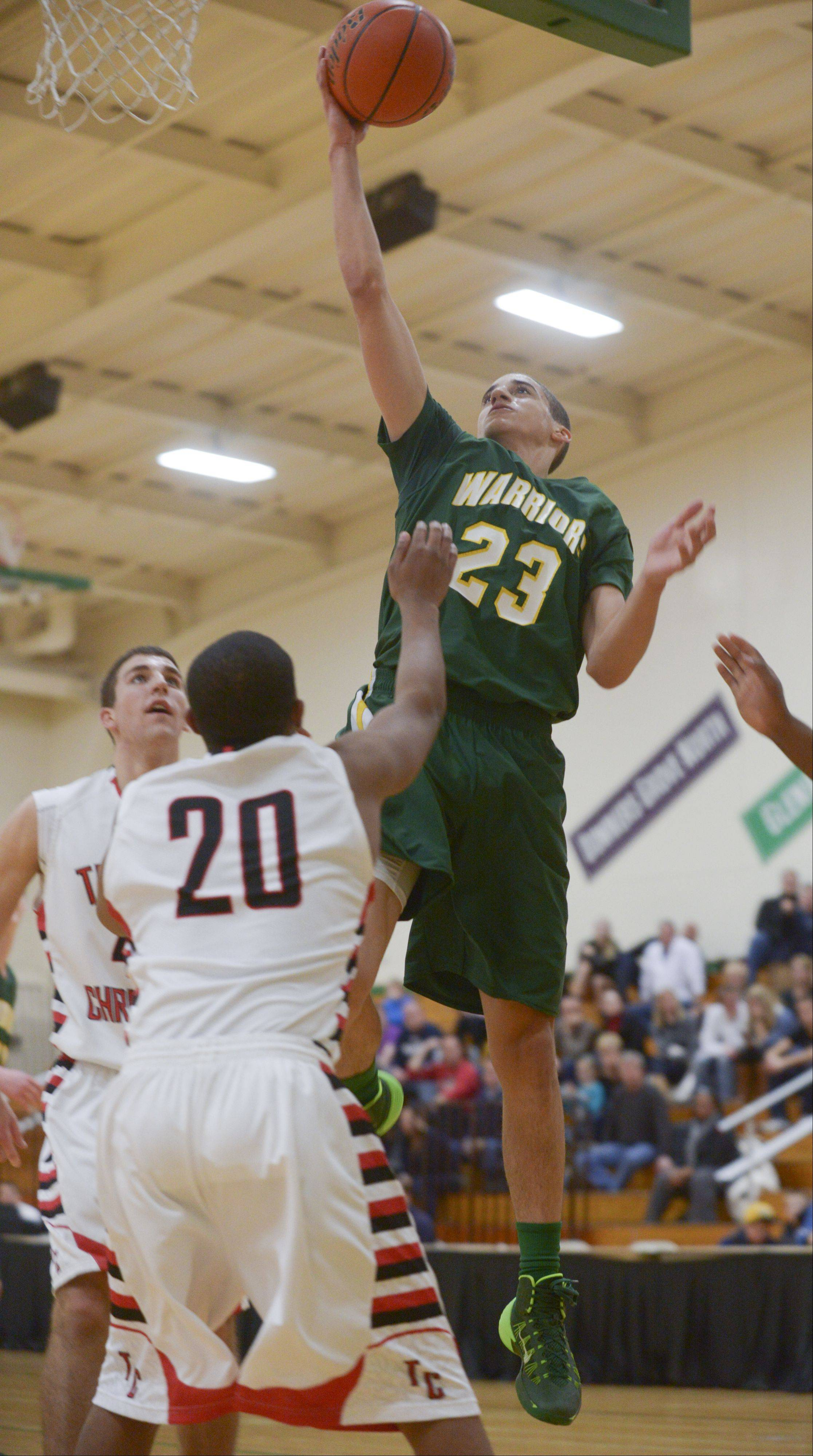 Waubonsie Valley's Jay DeHaan goes up for a shot getting past Timothy Christian's Joe Bishop during the Jack Tosh Holiday Classic at York High School Monday.