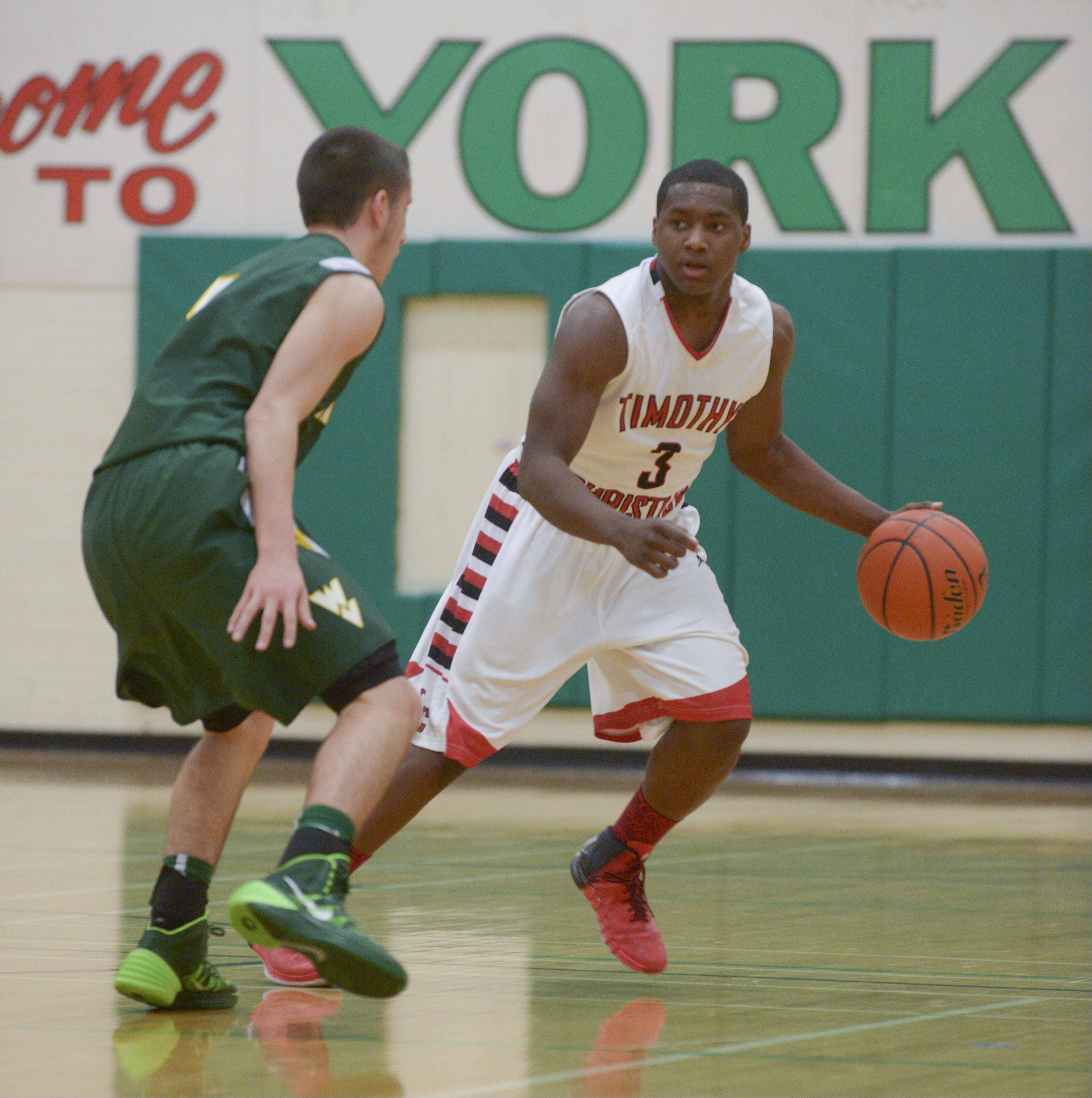 Timothy Christian's Malik Hughes looks to drive the ball down the court during the Trojans 36-25 loss to Waubonsie Valley during the Jack Tosh Holiday Classic at York High School Monday.