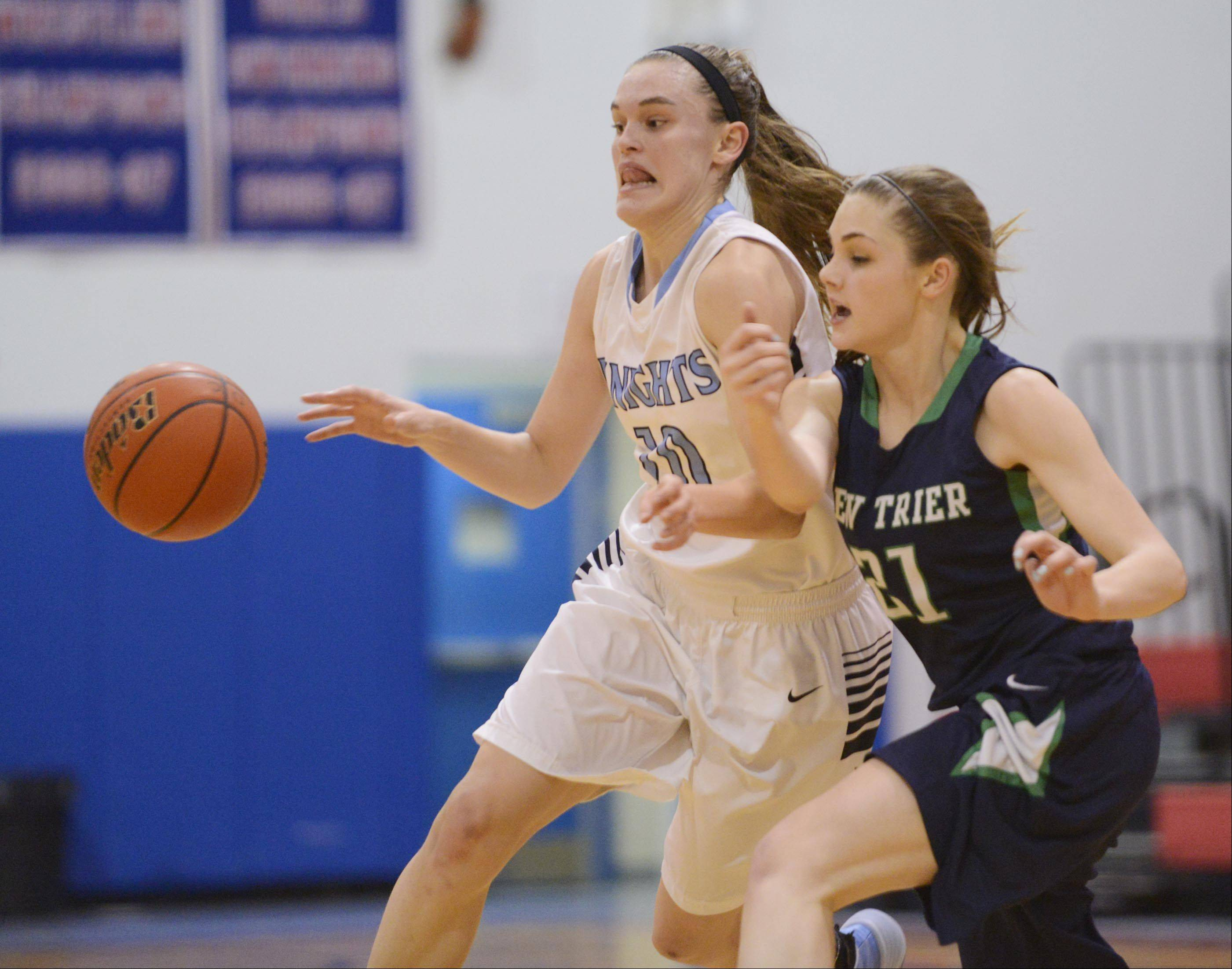 New Trier's Isabella Bosco knocks the ball from Prospect's Taylor Will Monday in the championship game of the 31st Annual Charger Classic at Dundee-Crown on Monday.