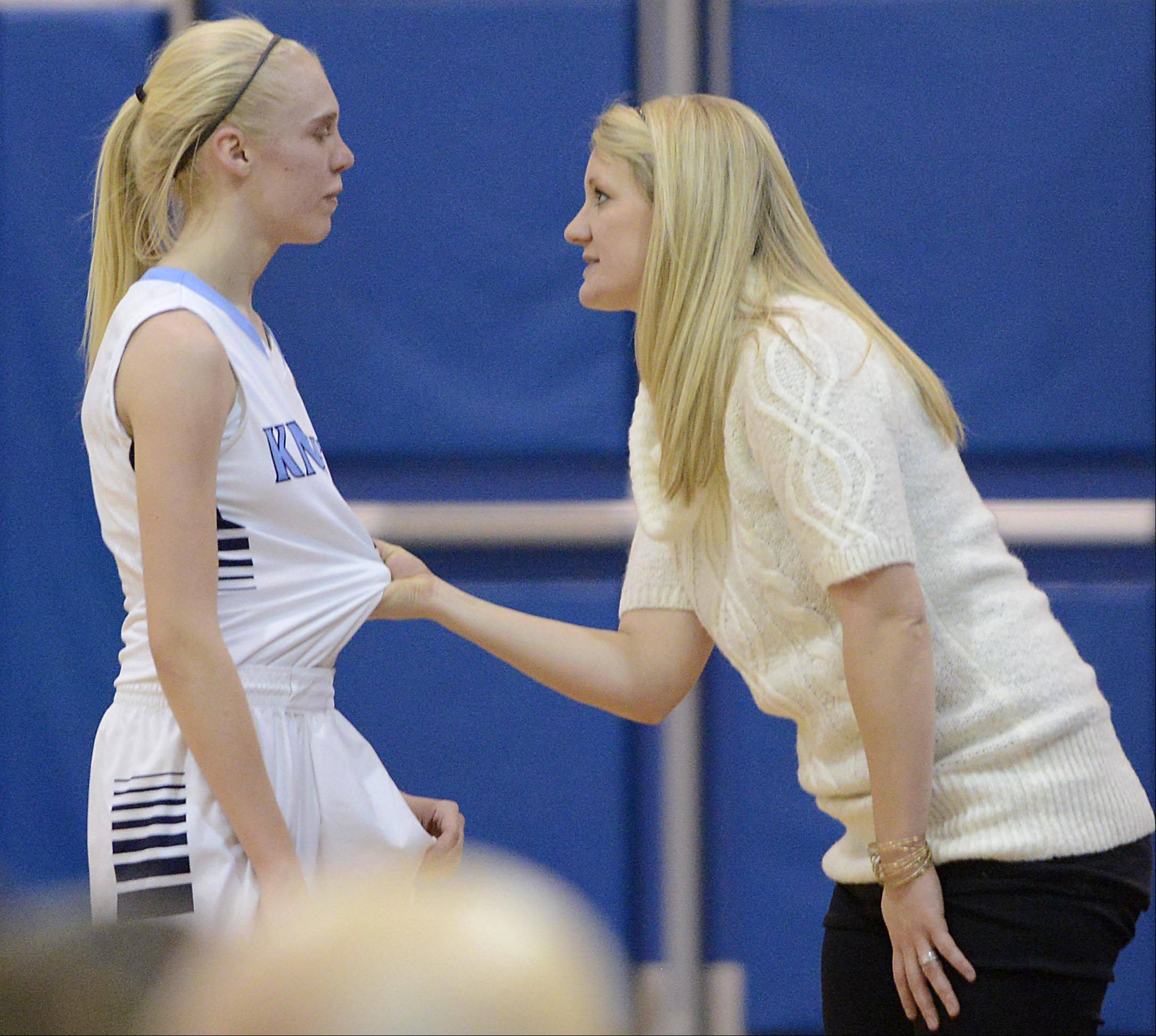 Prospect coach Ashley Graham talks with Haley Will during the Knight's meeting with New Trier in the championship game of the 31st Annual Charger Classic at Dundee-Crown on Monday.