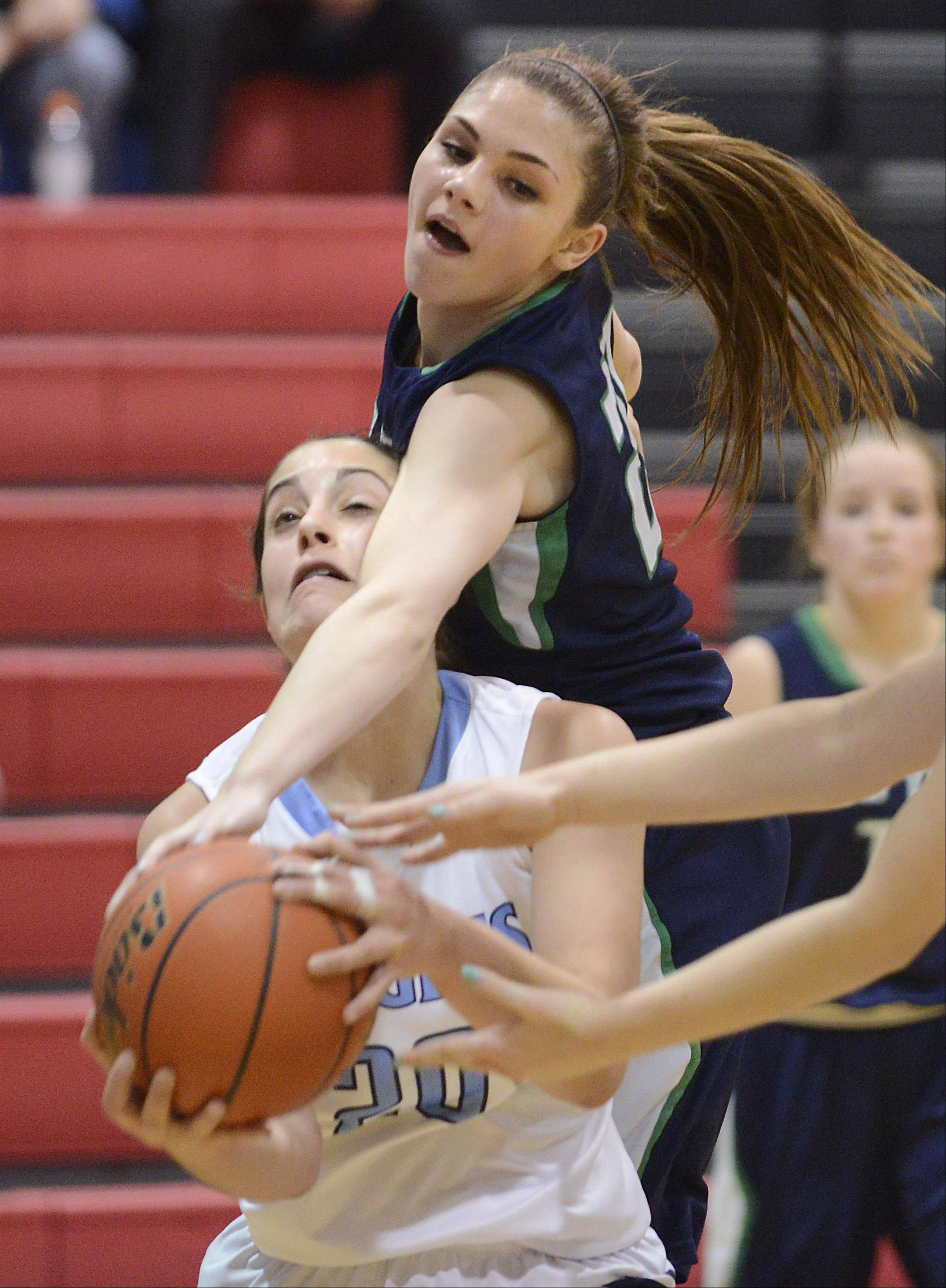 New Trier's Isabella Bosco fouls Prospect's Christina D'Anza in the championship game of the 31st Annual Charger Classic at Dundee-Crown on Monday.
