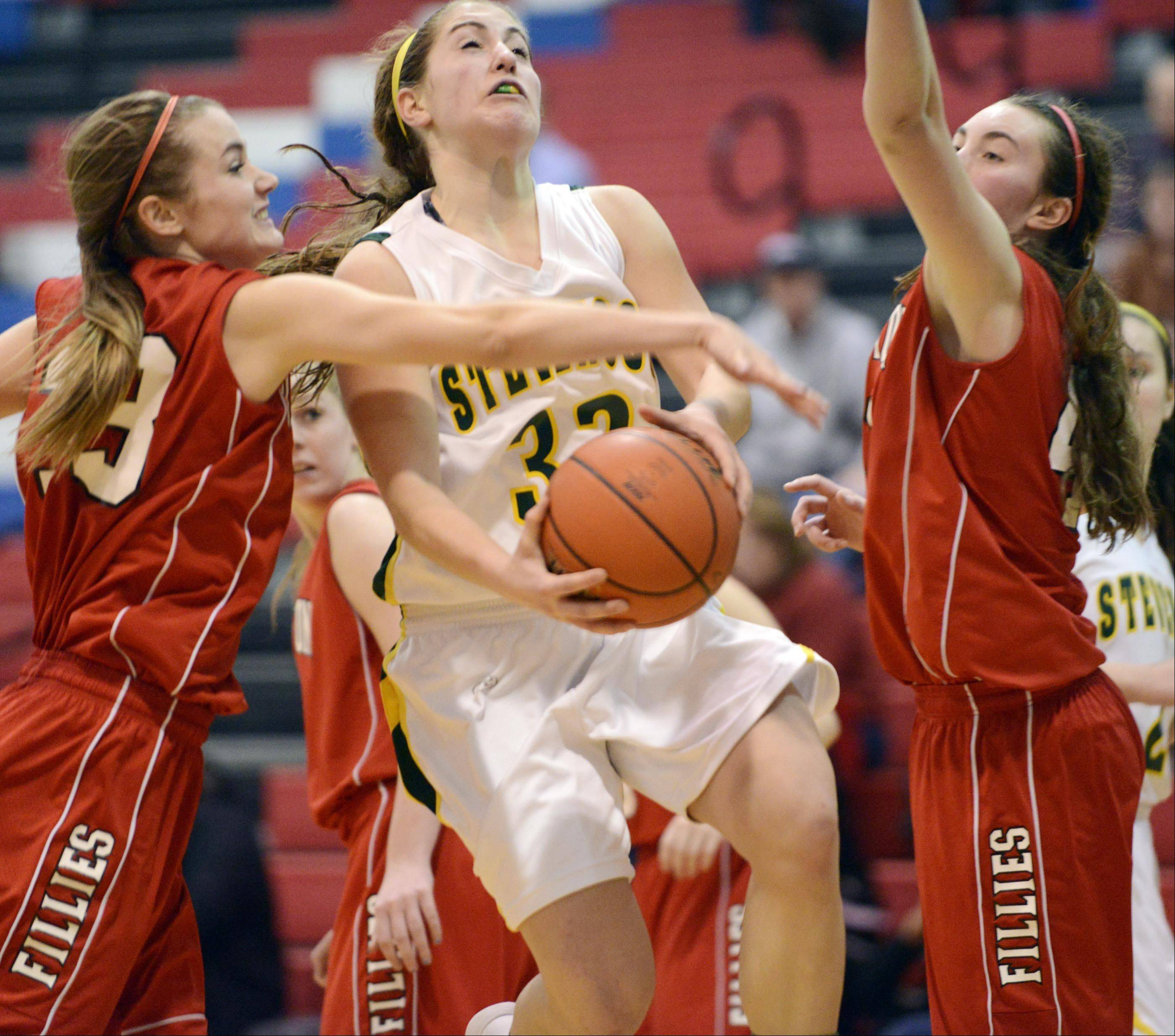 Barrington's Angie Kirchoff tries to block a shot by Stevenson's Sophia Way.