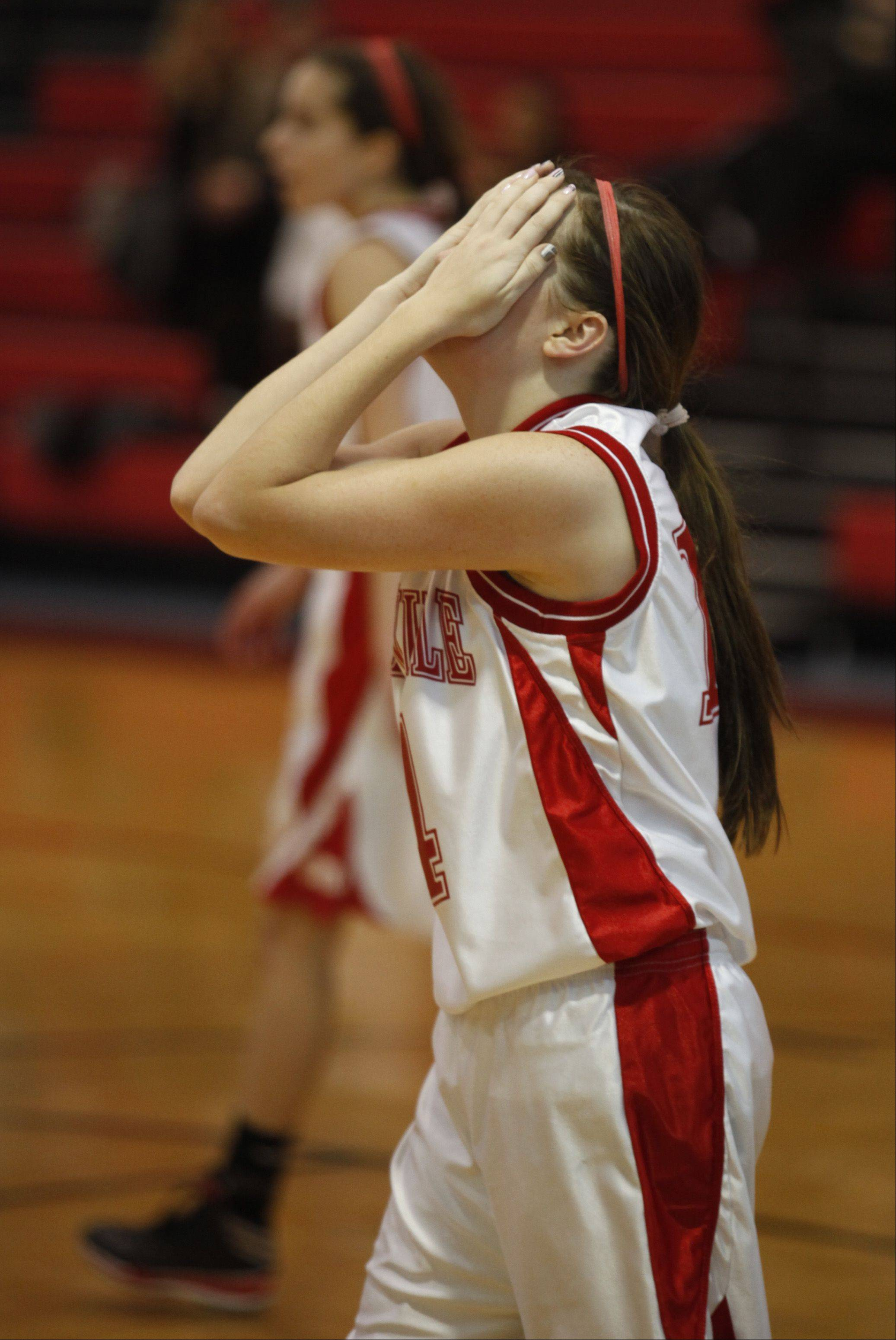 Naperville Central's Emily Kraft can't believe she was called for an offensive foul during the first half.