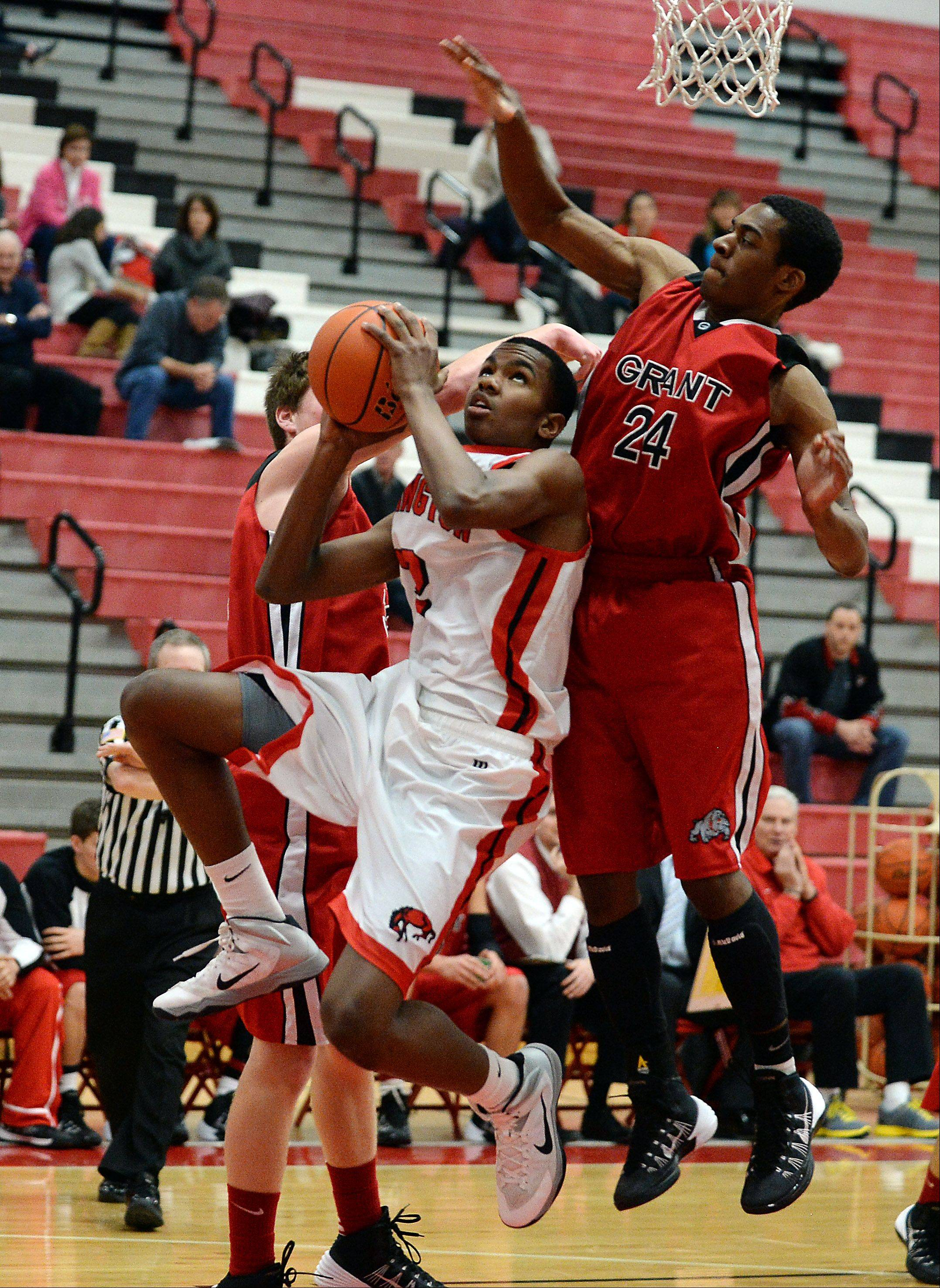 Grant's Mike Burns fouls Barrington's Chris Lester.