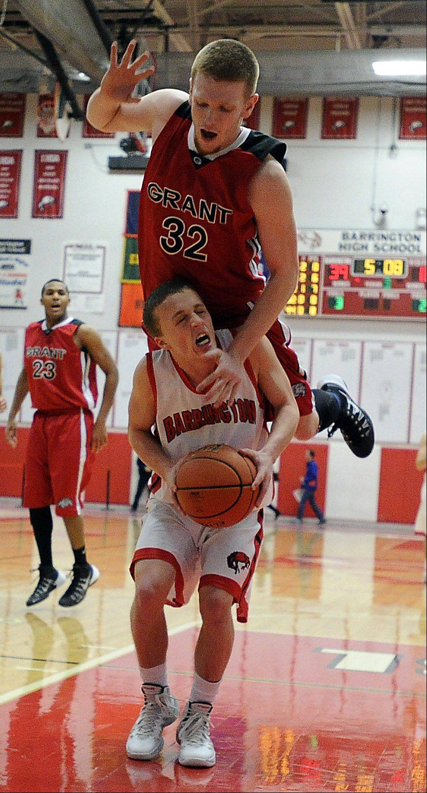 Grant's Devin Bald goes up and over Barrington's Jake Orr.