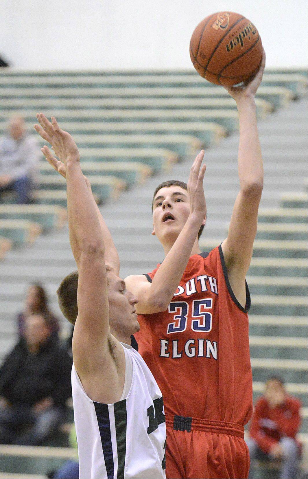 Tyler Hankins, here shooting against Bartlett's Brian Triphahn, helped South Elgin finish up with a four-game win streak in Hinkle Holiday Classic play at Jacobs.