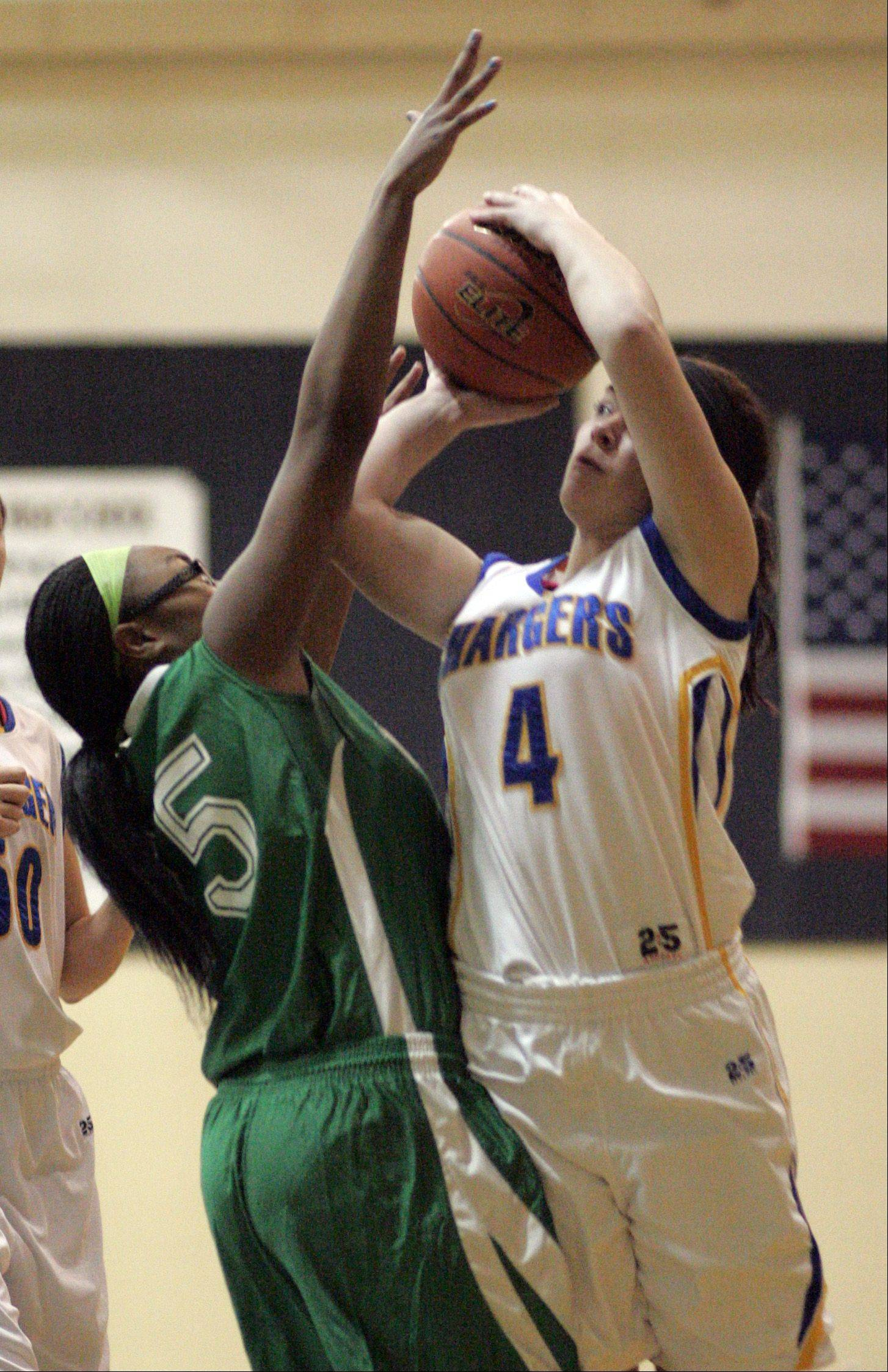 Walther Christian's Abbie Hanson, pressures ACC's Maggie O'Brien at Aurora Central Catholic.