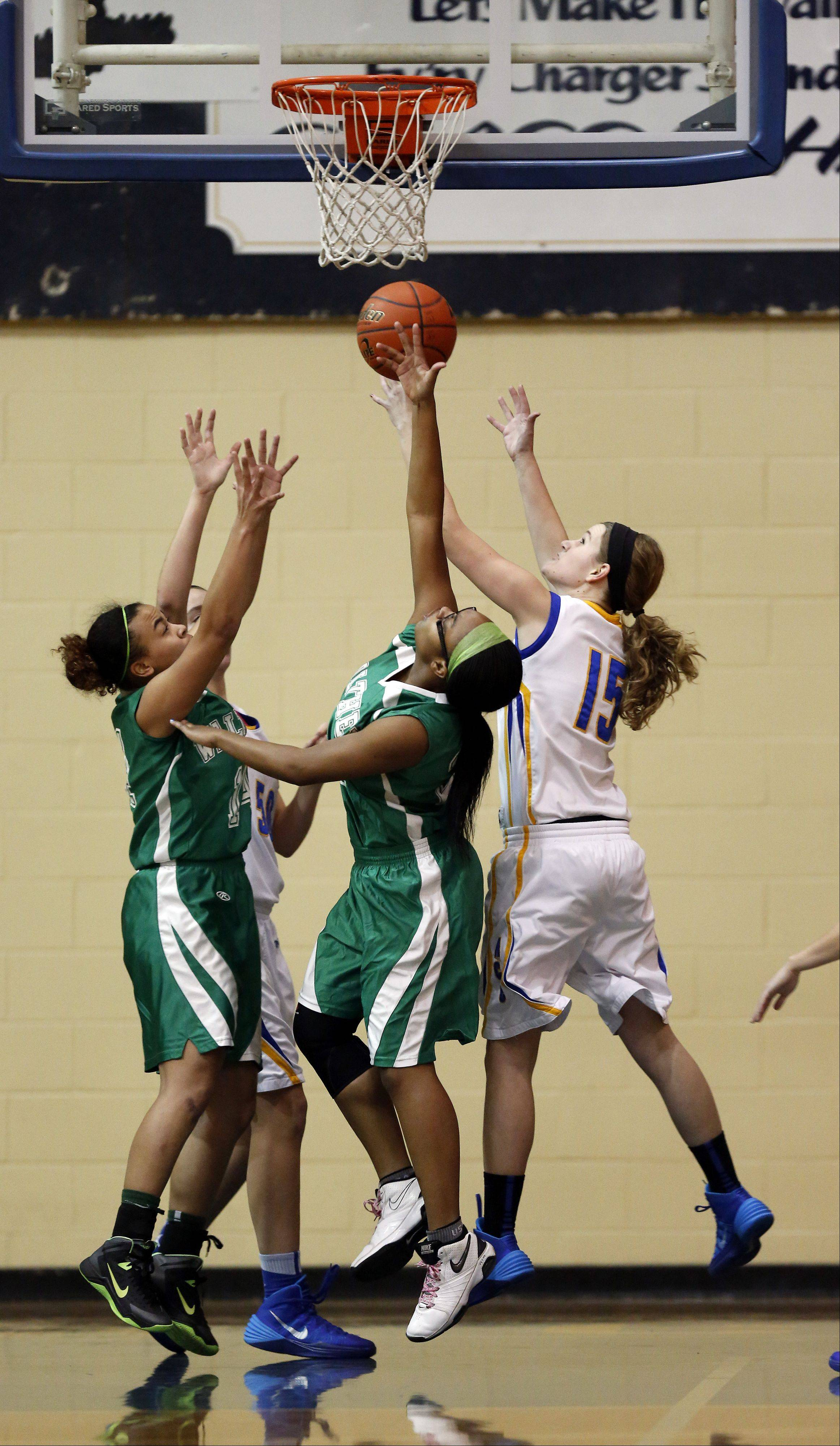 Walther Christian's Kreonna Burnett and ACC's Natalie Droeske battle for a rebound.