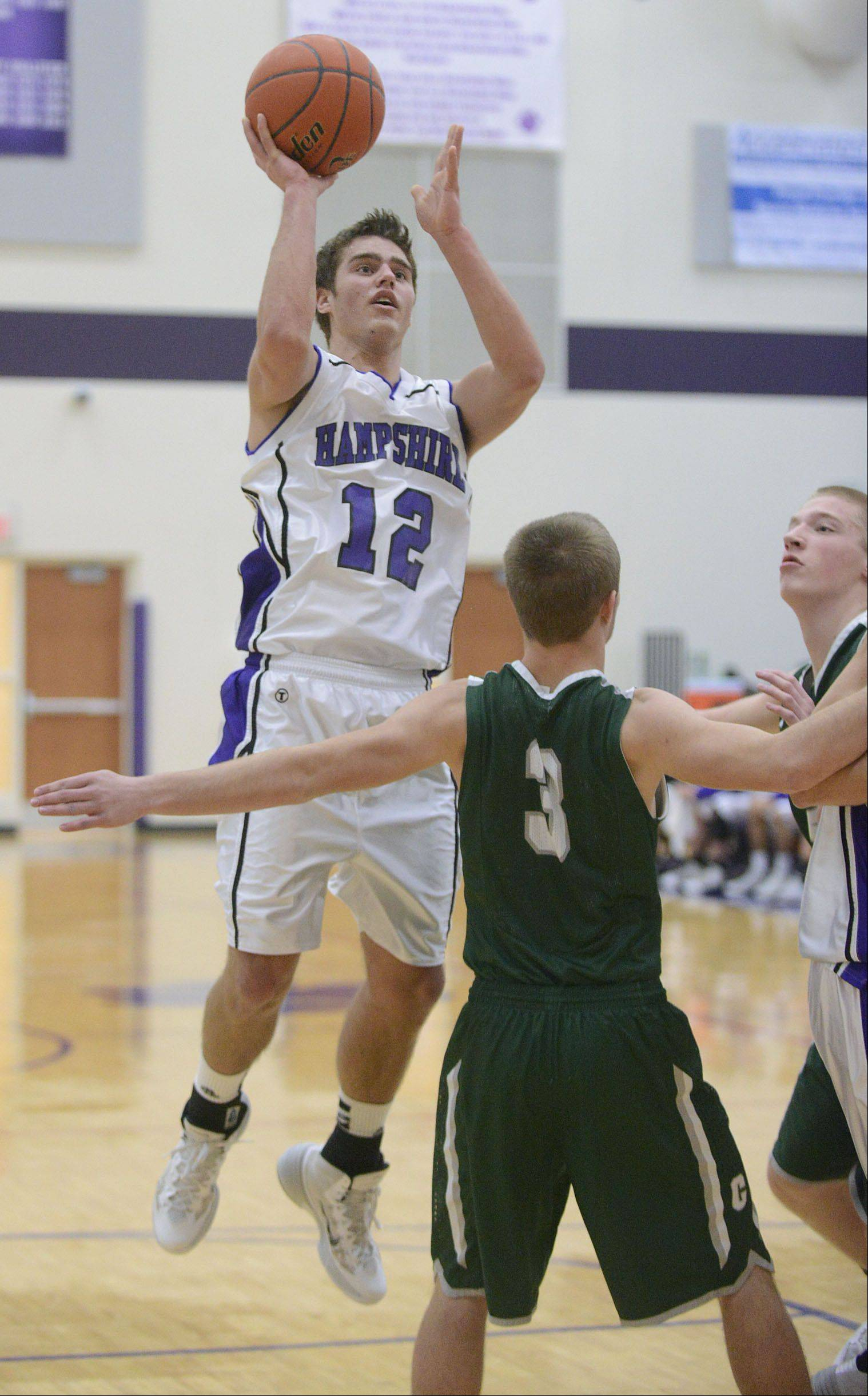 Hampshire's Matthew Bridges shoots over Grayslake Central's Matt Loeffl in the first quarter on Saturday, January 4.
