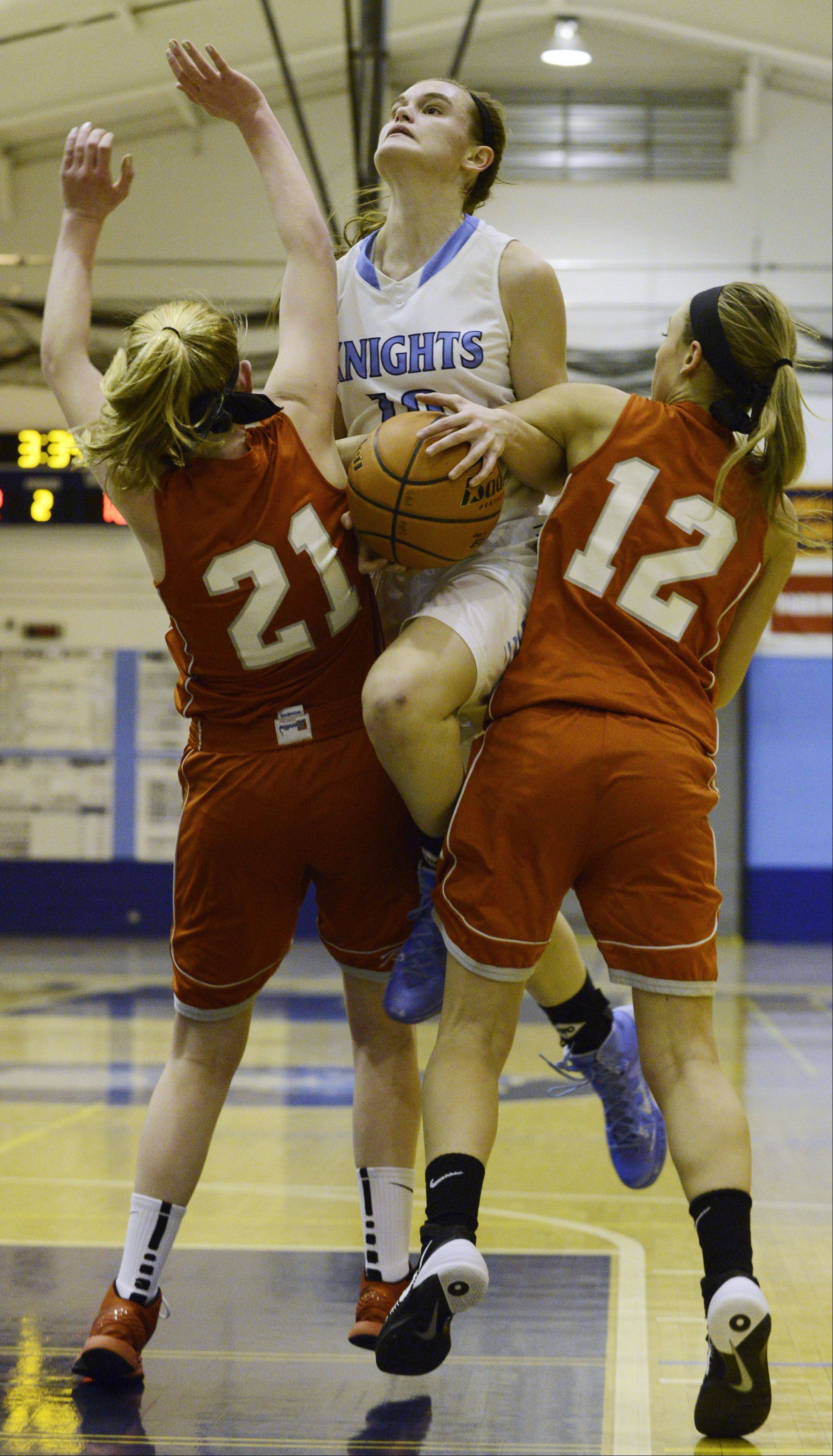 Prospect's Taylor Will is fouled as she tries to step between Palatine's Morgan Radtke, left, and Kristen Allen on Tuesday.