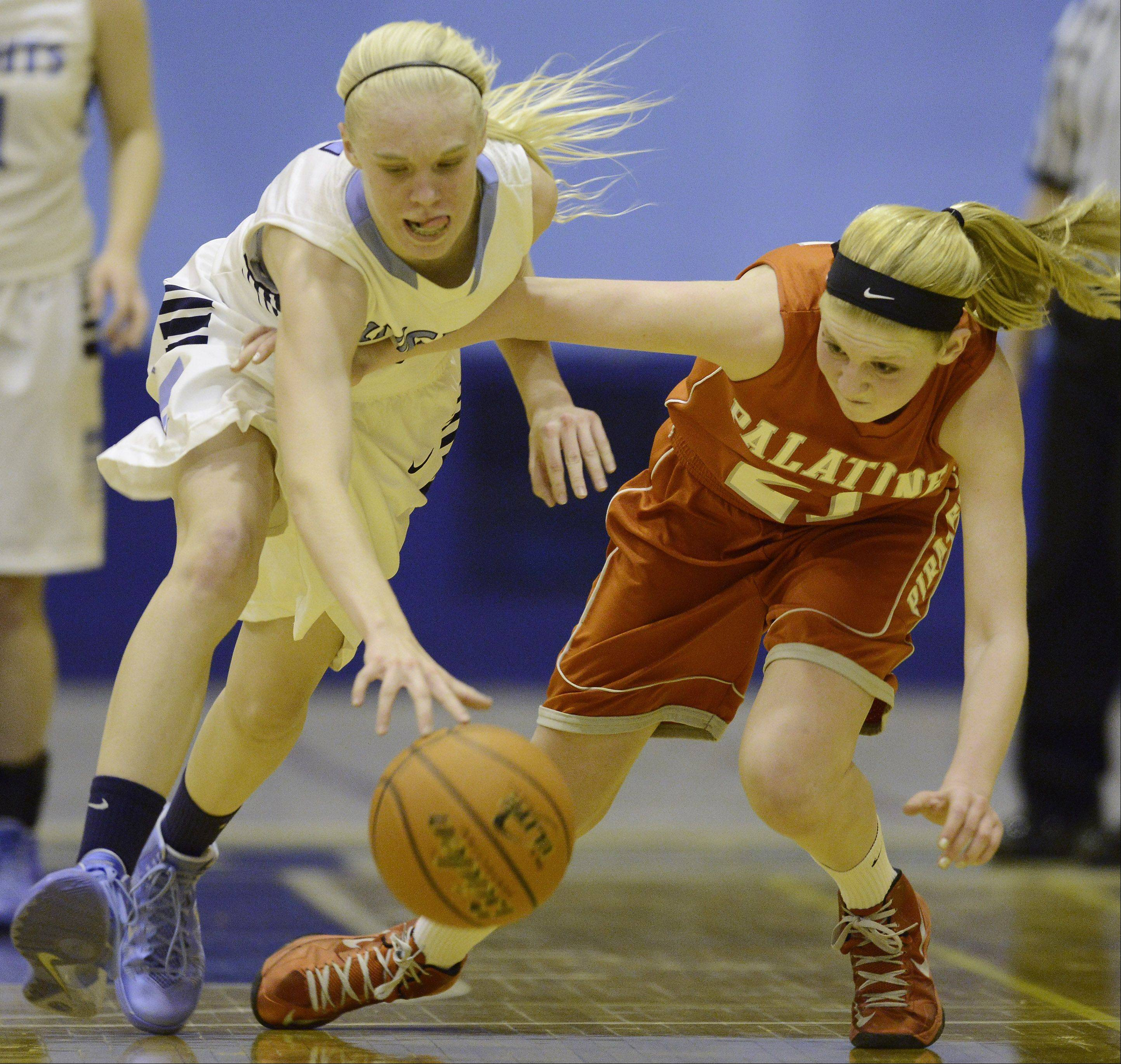 Prospect's Haley Will, left, steals the ball from Palatine's Morgan Radtke during Tuesday's game.