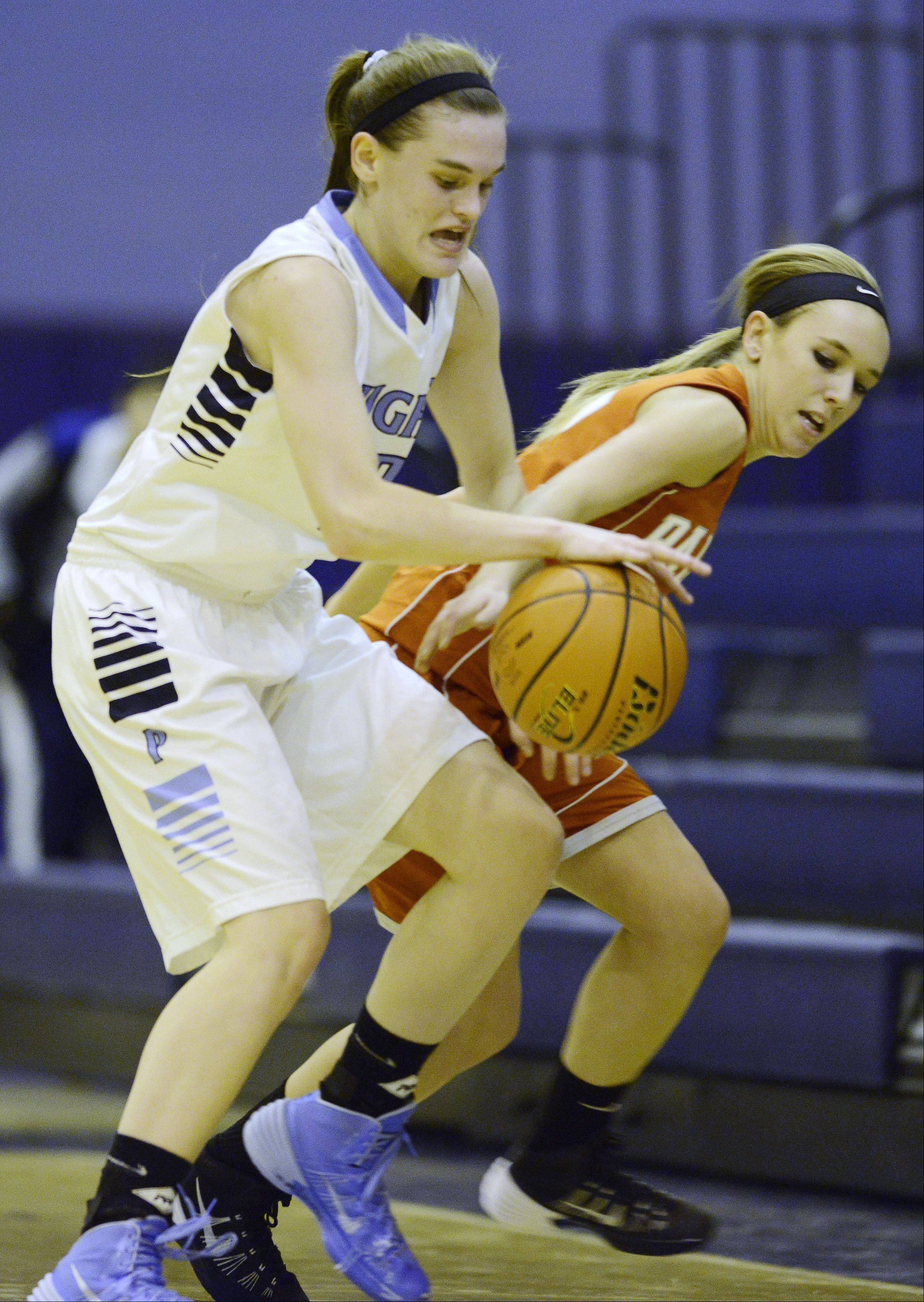 Prospect's Taylor Will, left, beats Palatine's Kristen Allen to a loose ball during Tuesday's game.