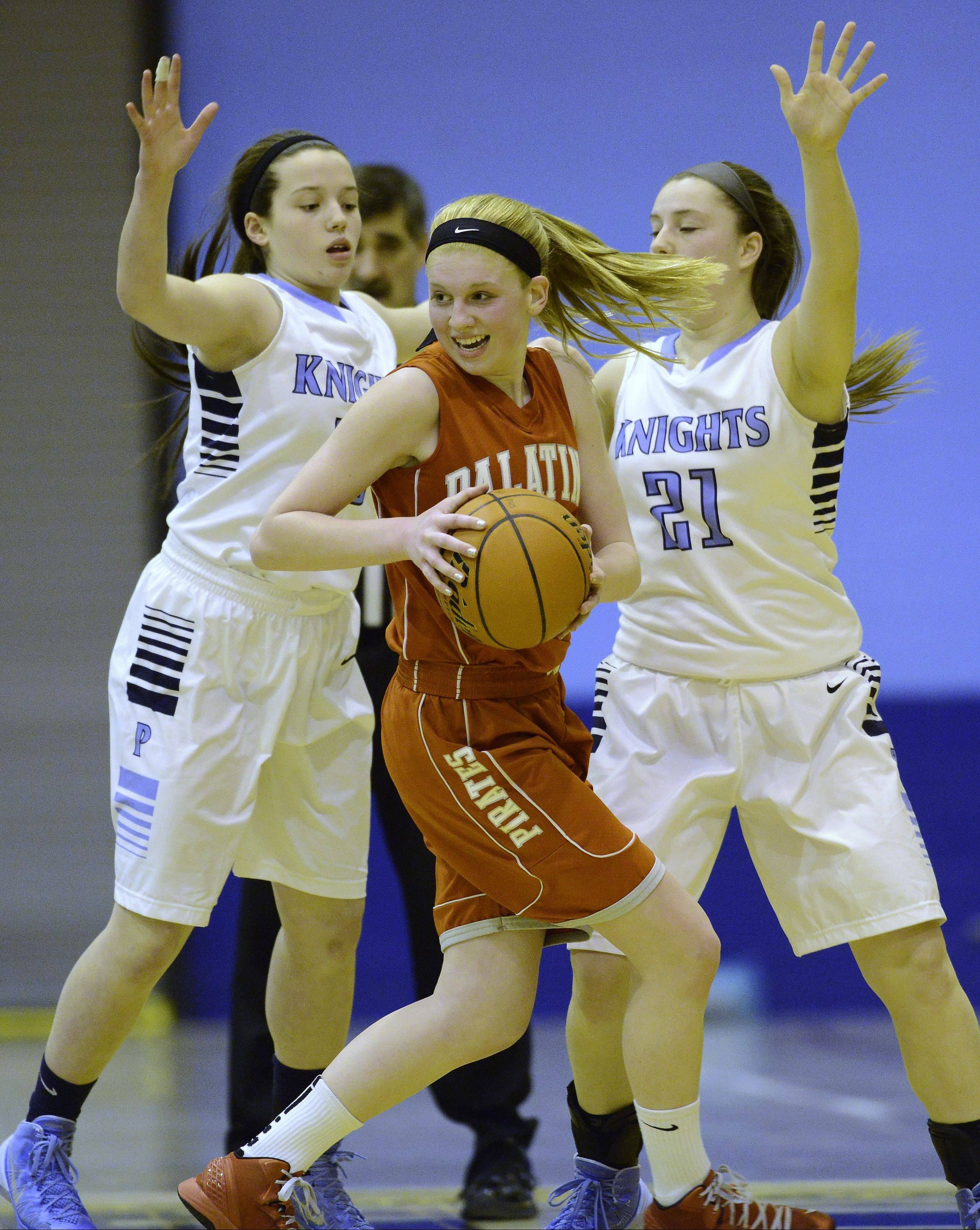 Palatine's Morgan Radtke, middle, looks for an opening against Prospect defenders Nikki Matters, left, and Marissa Pacini on Tuesday.