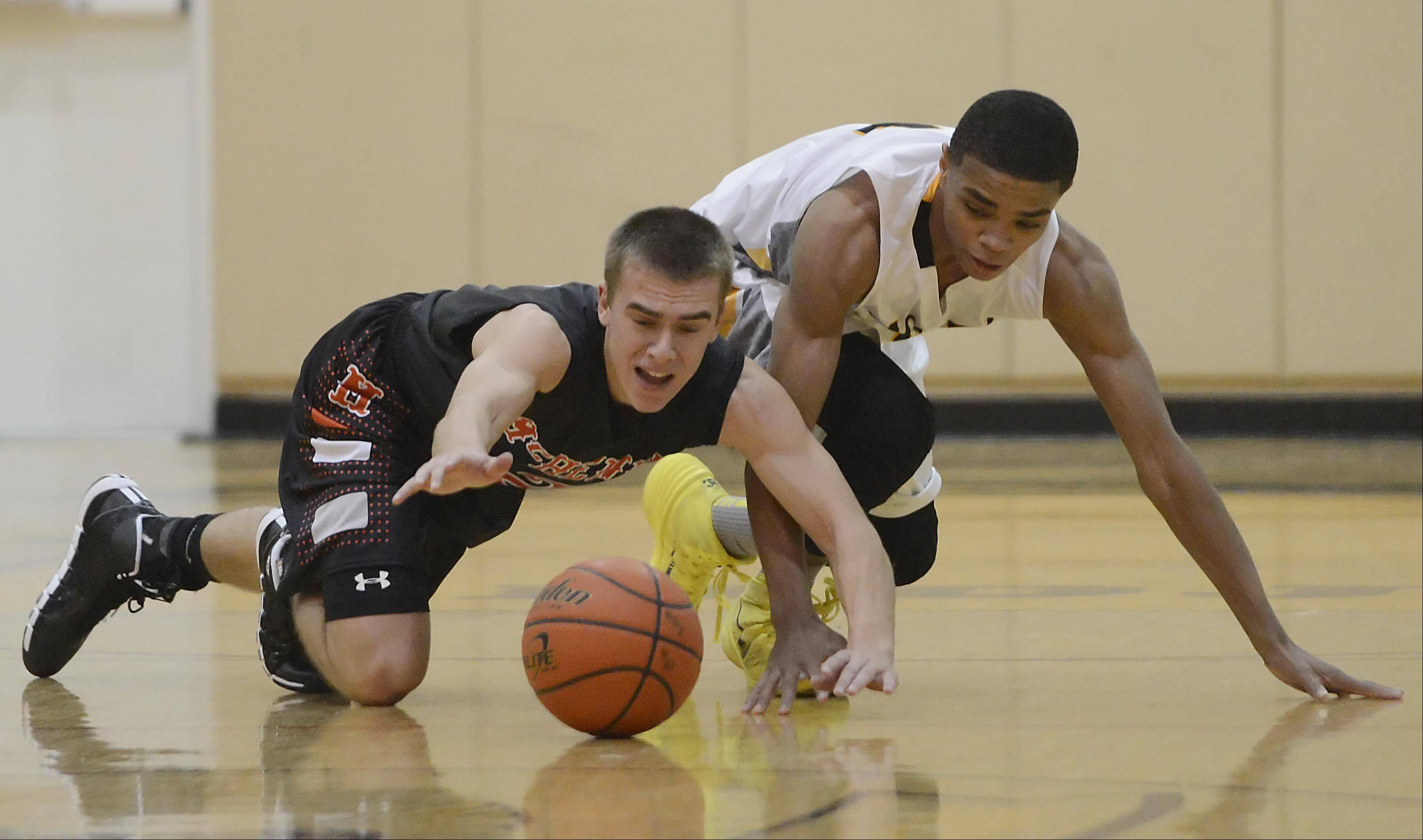 McHenry's Cody Freund and Jacobs' Kenton Mack scramble for a loose ball Wednesday in Algonquin.