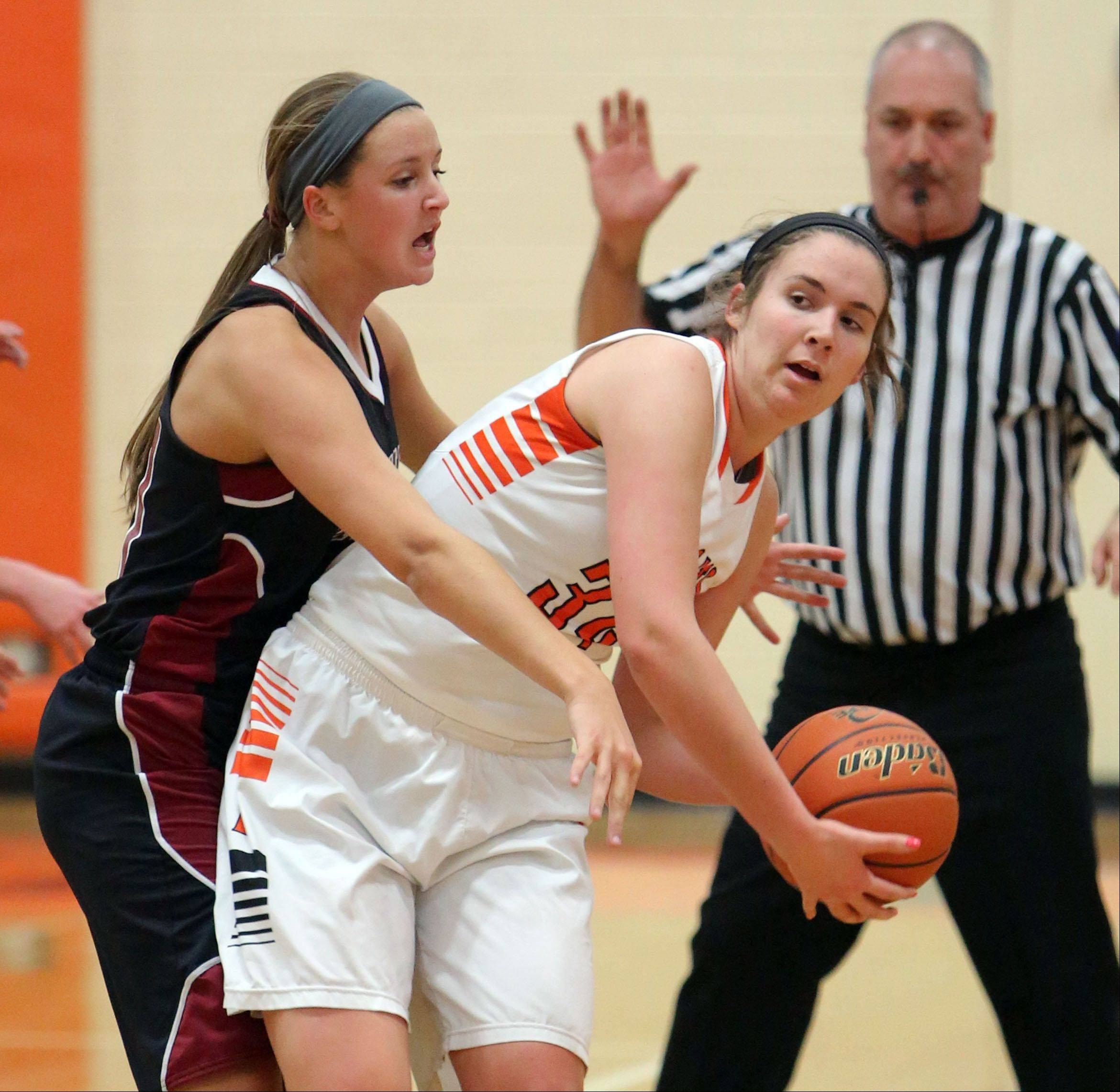 Antioch's Carly McCameron, left, applies defense on Libertyville's Becky Deichl.
