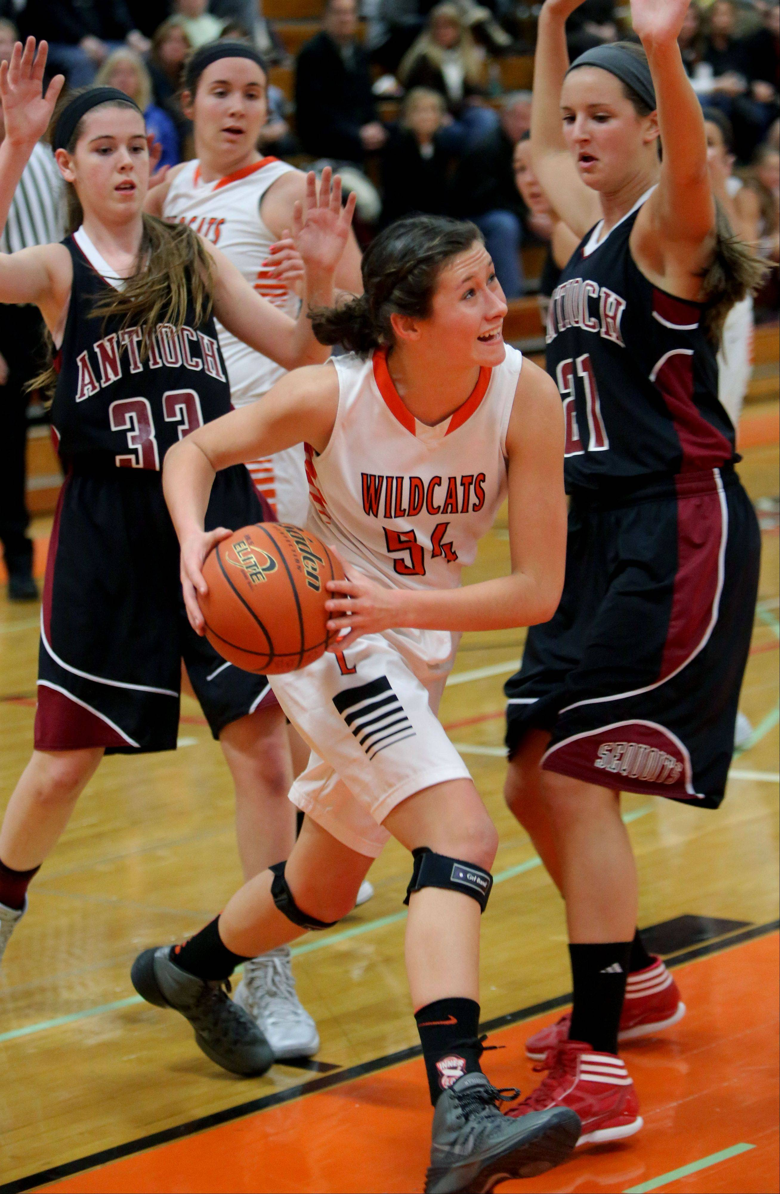 Libertyville's Claire Keefe splits the defense of Antioch's Kelly Johnson, left, and Carly McCameron.