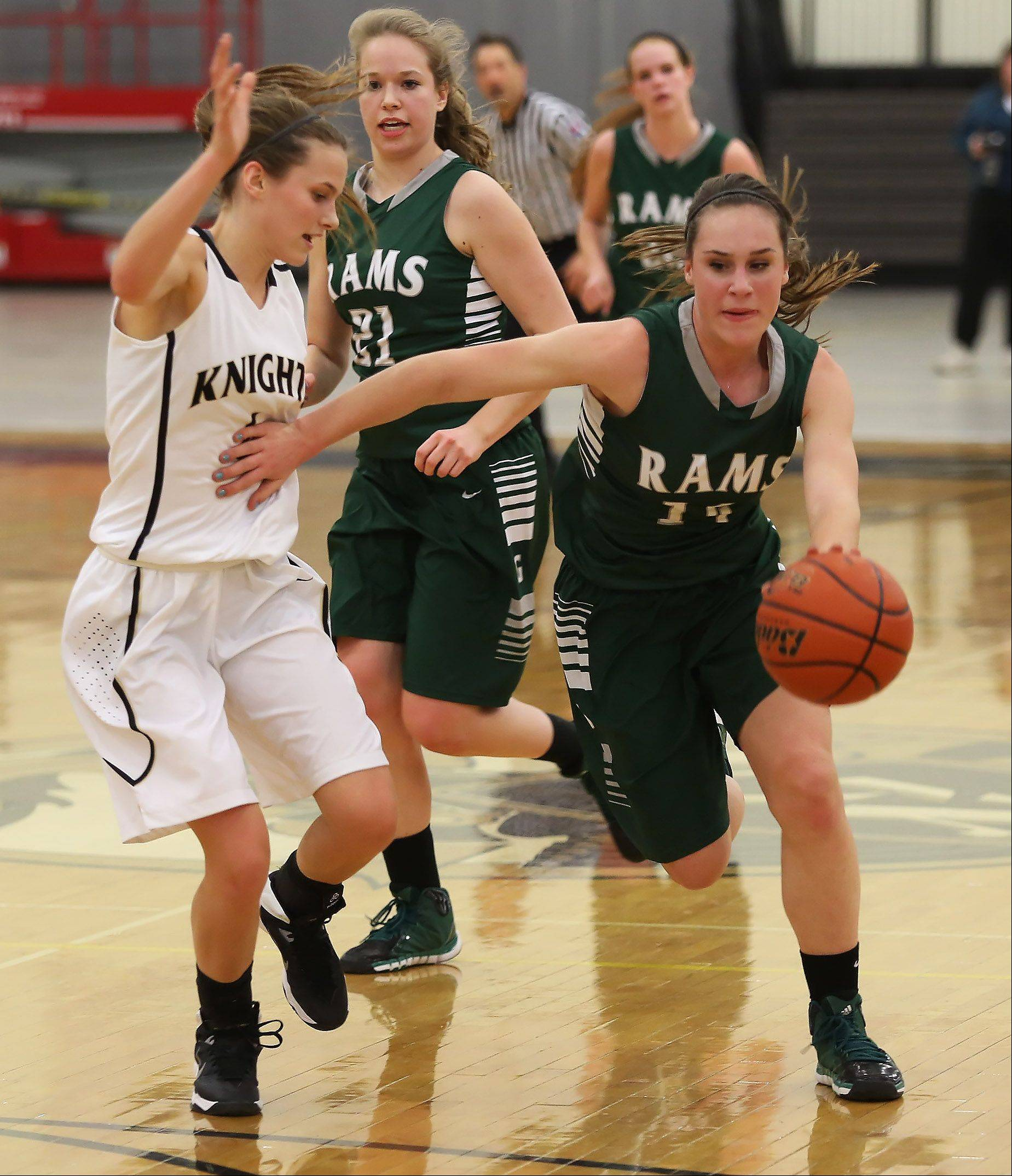 Grayslake Central guard Kayley Larson pushes Grayslake North guard Maggie Fish on a drive to the basket Thursday at Grayslake North.