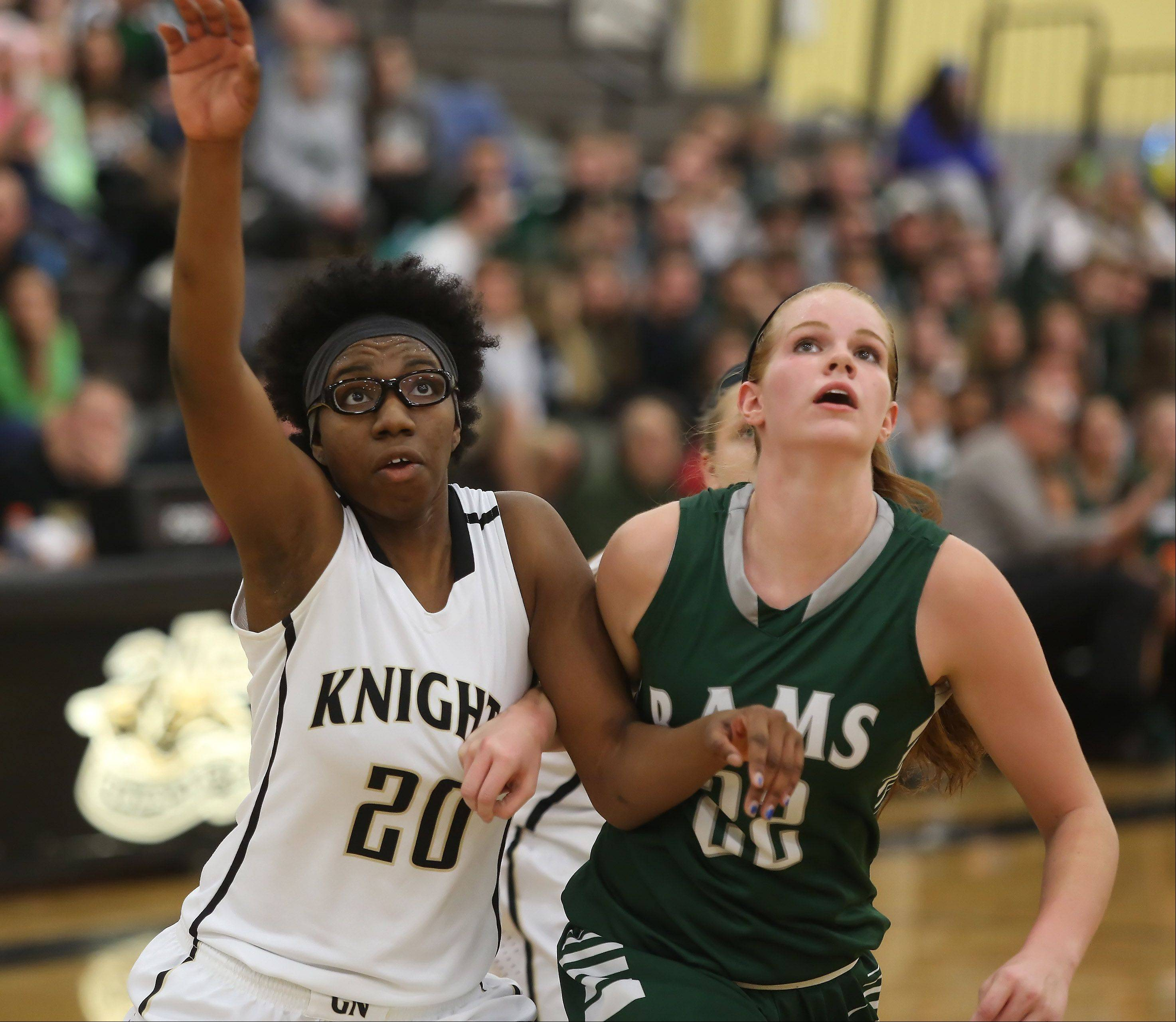Grayslake North forward Brittney Thibeaux, left, battles Grayslake Central forward Morgan Dahlstrom for the rebound Thursday at Grayslake North.
