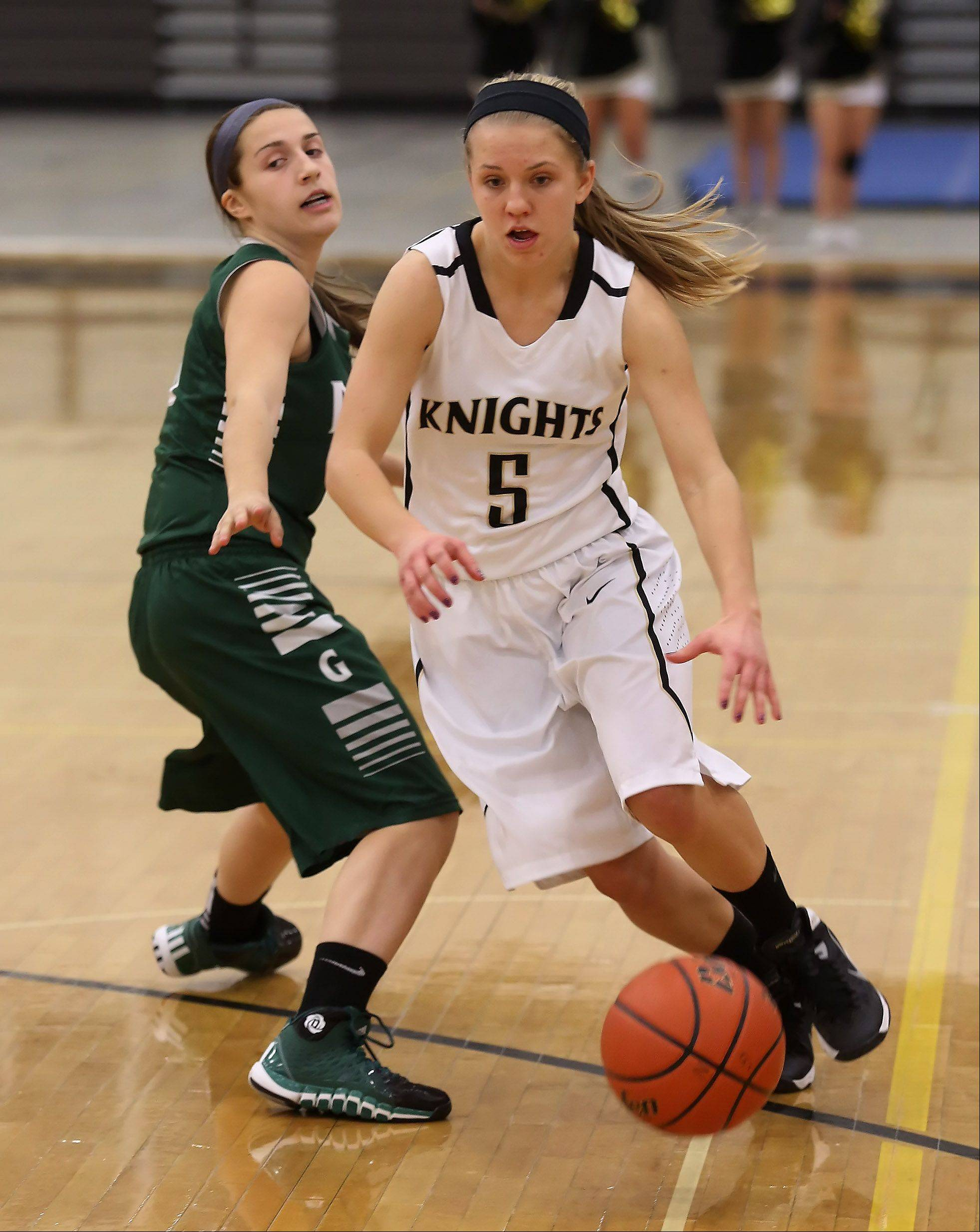 Grayslake North guard Kendall Detweiler drives around Grayslake Central guard Quinn Garbett on Thursday at Grayslake North.