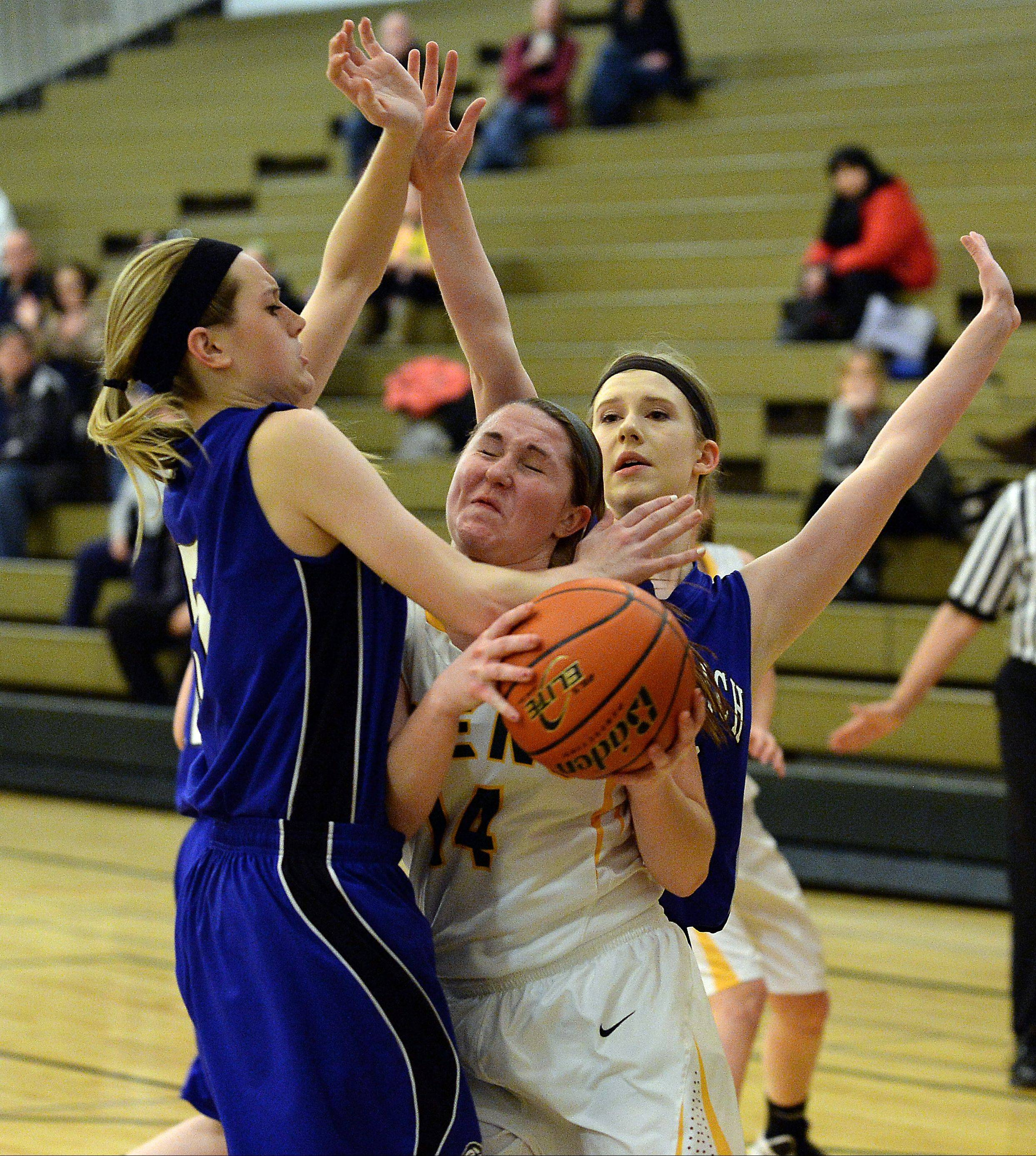 Lake Zurich's Elly Daleske fouls Elk Grove's Taylor Brown as she drives for the basket Thursday at Elk Grove.