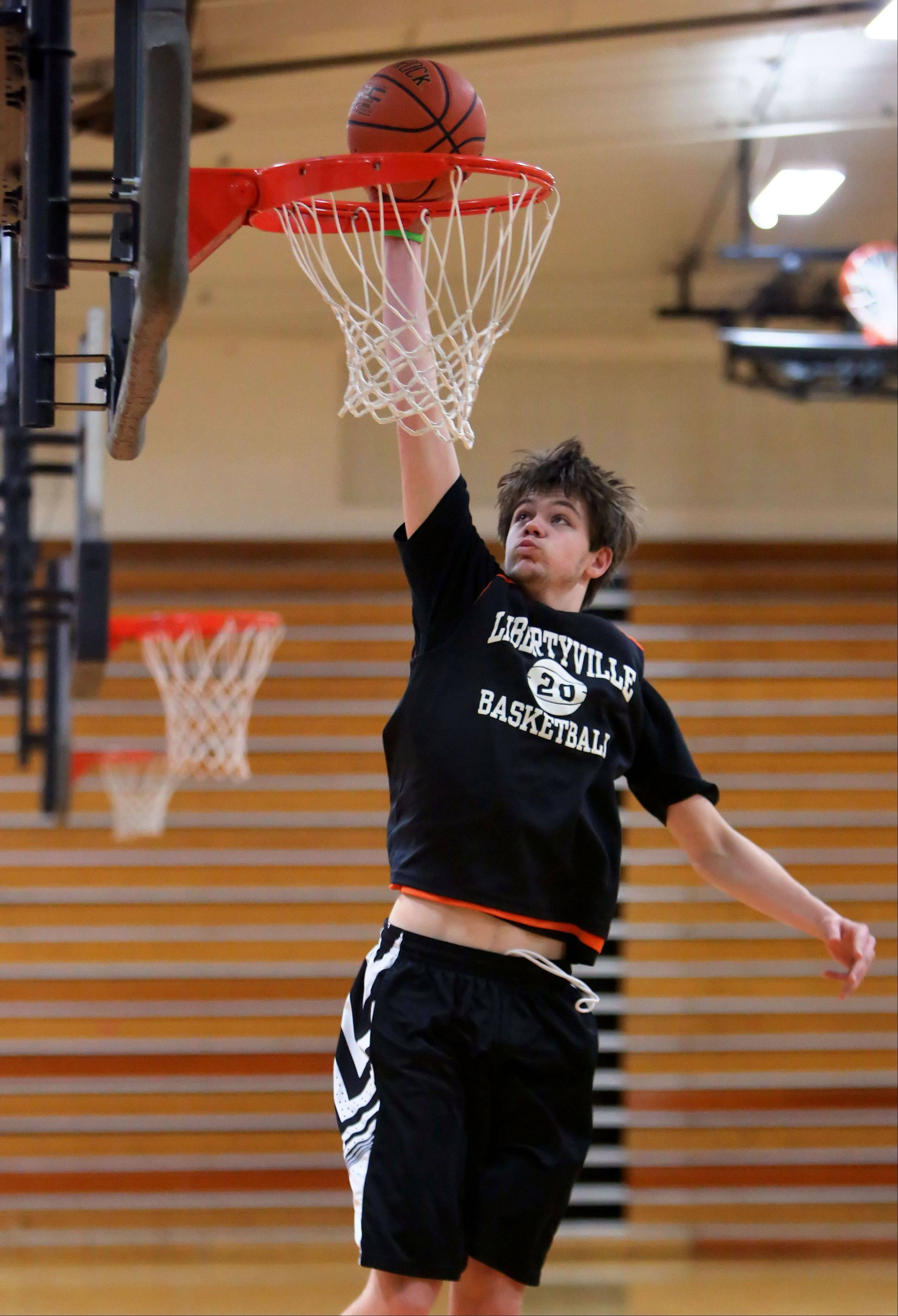 Libertyville center Joe Borcia goes in for a dunk during practice. Borcia is developing into a very impressive player. He's one of the better big men in the NSC.