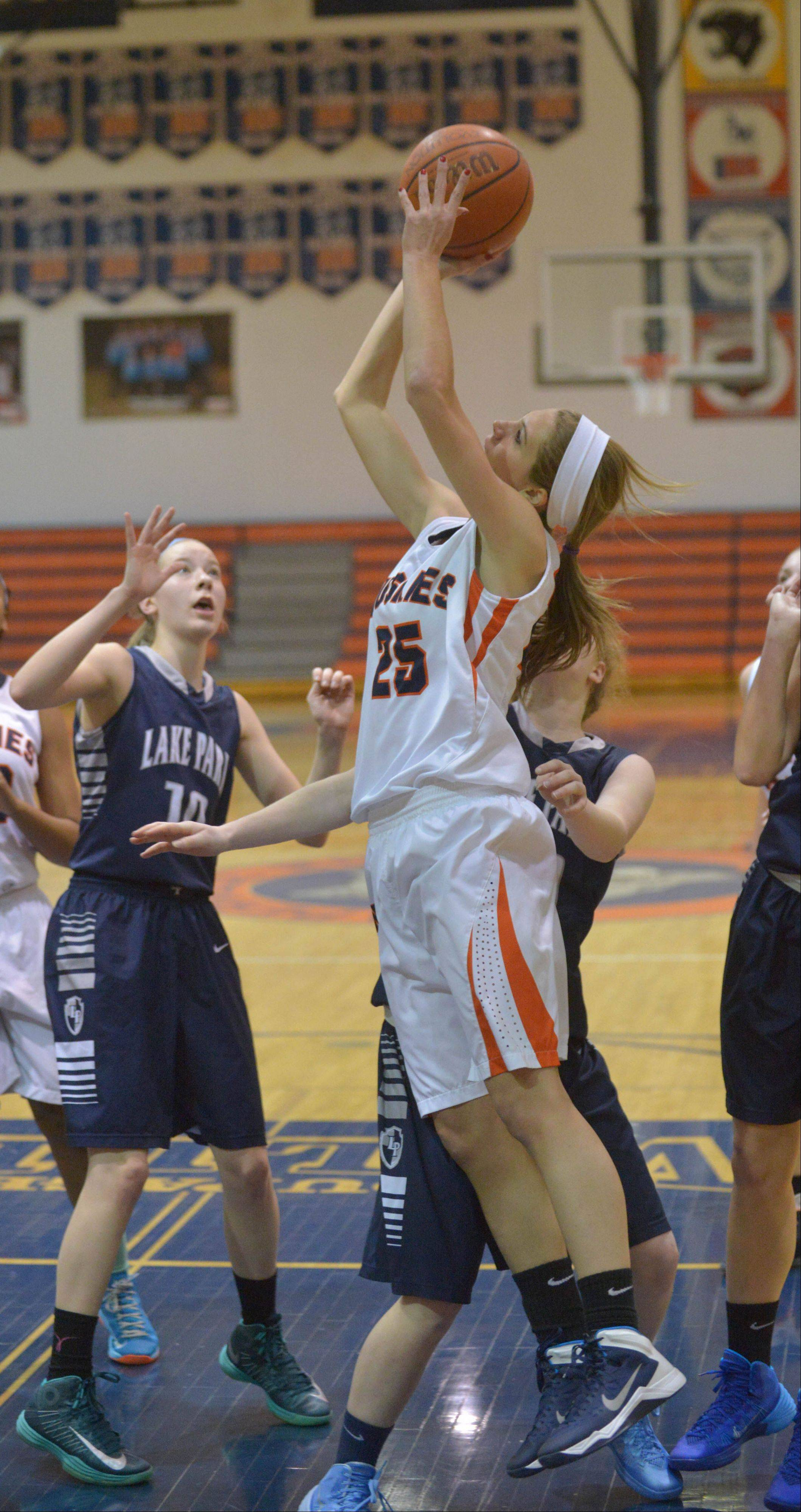 Kayla Sharples of Naperville North takes a shot .