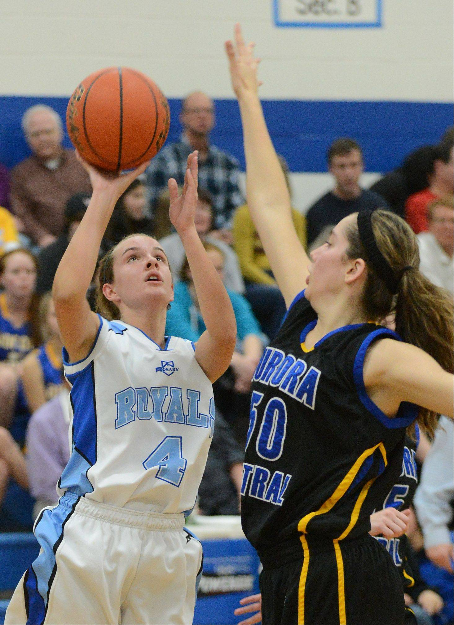Rosary's Emily Bakala puts up a shot with Aurora Central Catholic's Taylor Harazin defending.