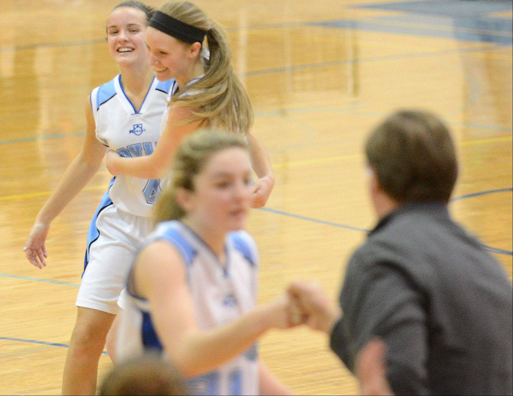 Rosary's Emily Bakala, left, and Rachel Choice celebrtate after their win over Aurora Central Catholic.