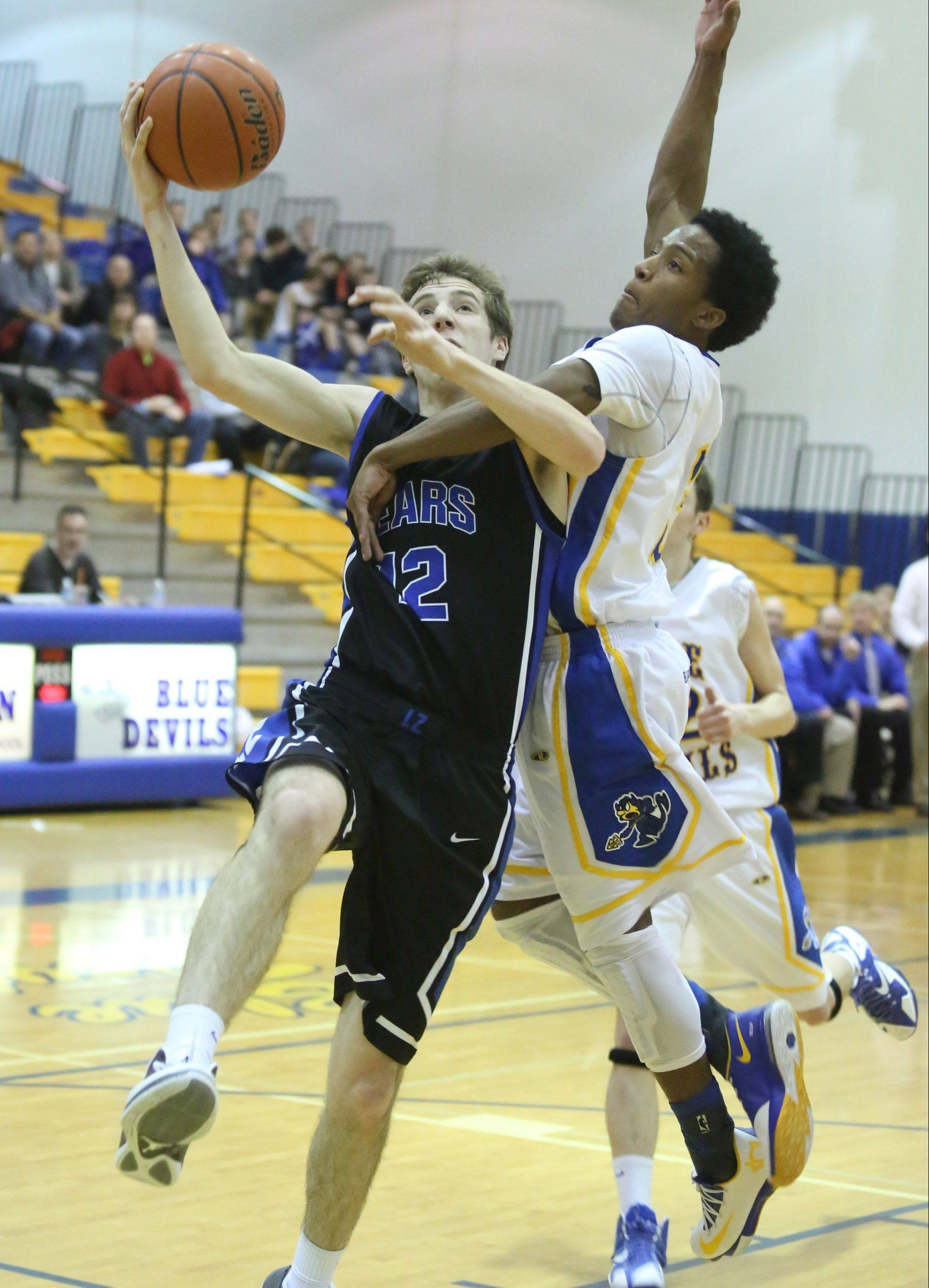 Warren defender Eric Gillespie is called for a foul against Lake Zurich forward Corey Helgeson on a breakaway to the basket on Friday at Warren in Gurnee.