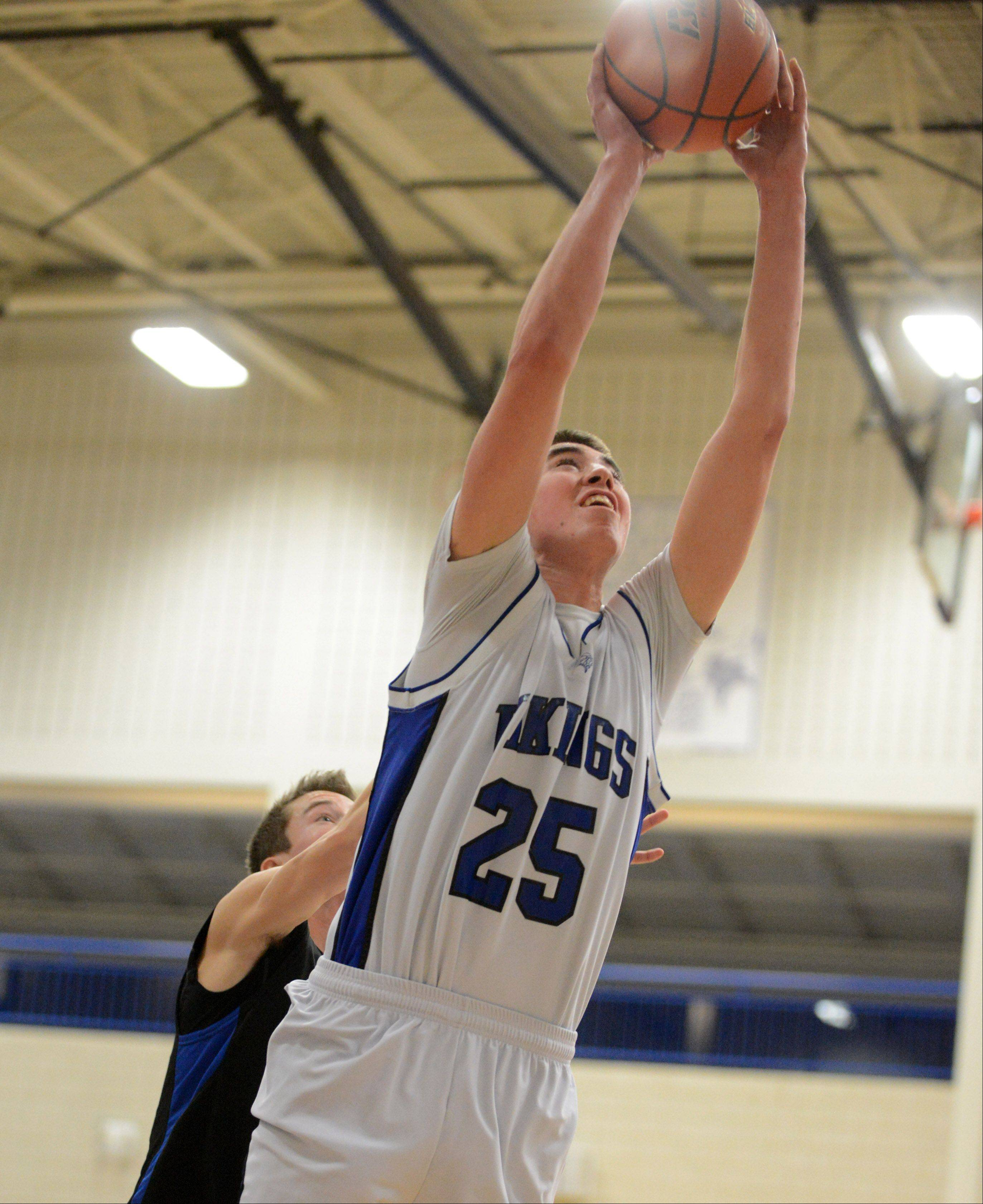 Geneva's Nate Navigato (25) lays one in during Friday's game in Geneva.