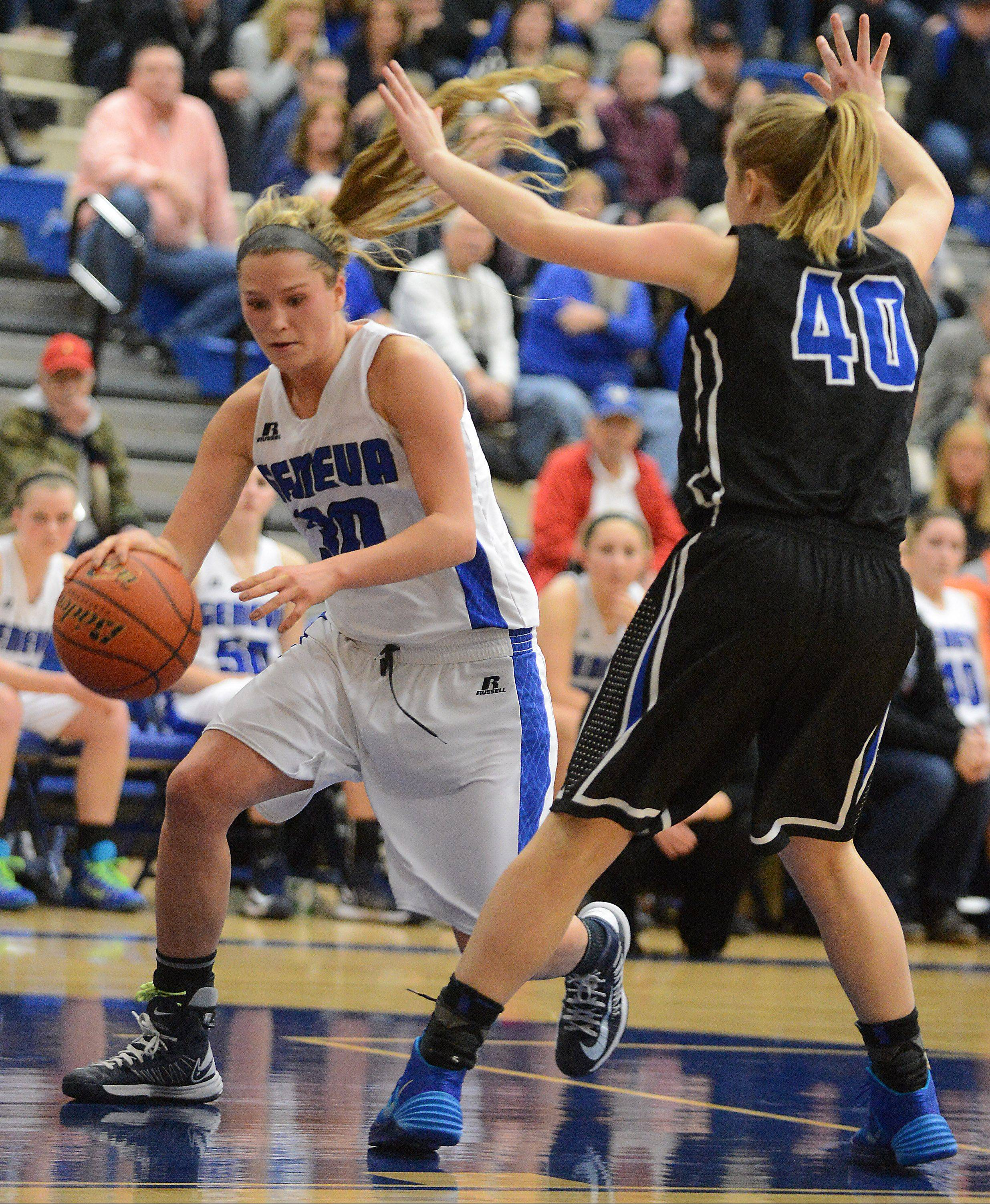 Geneva's Janie McCloughan drives to the basket against St. Charles North's Abby Mackay-Zacker during Friday's game.