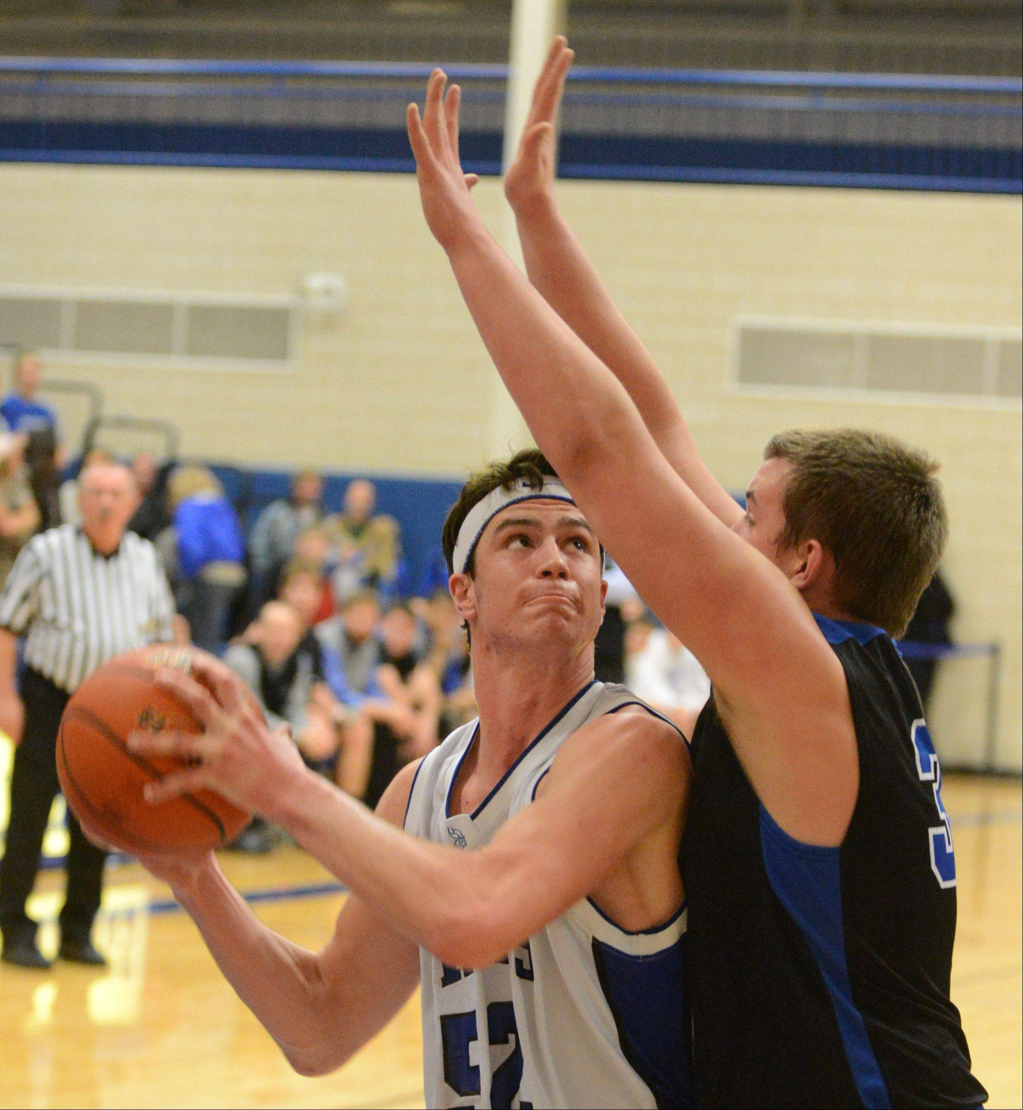 Geneva's Mike Landi looks for room to manuever under the basket.
