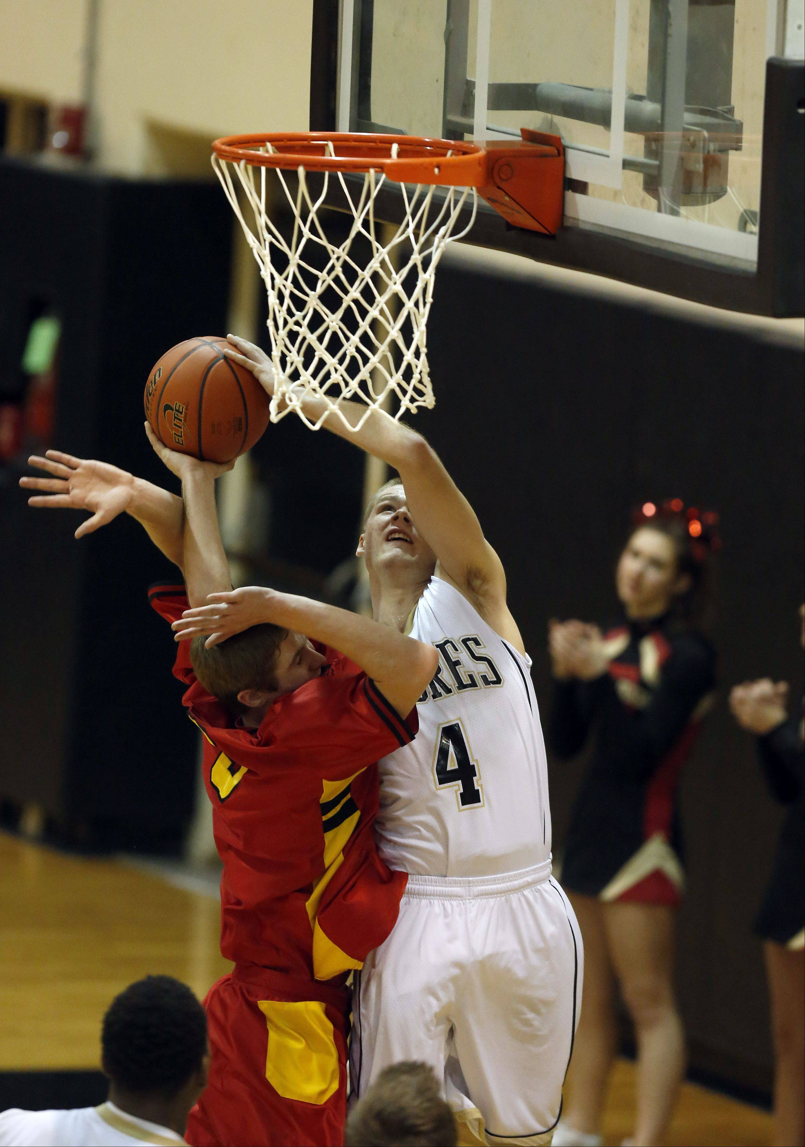 Batavia's Tucker Knox puts pressure on Streamwood's Jacob Siewert.