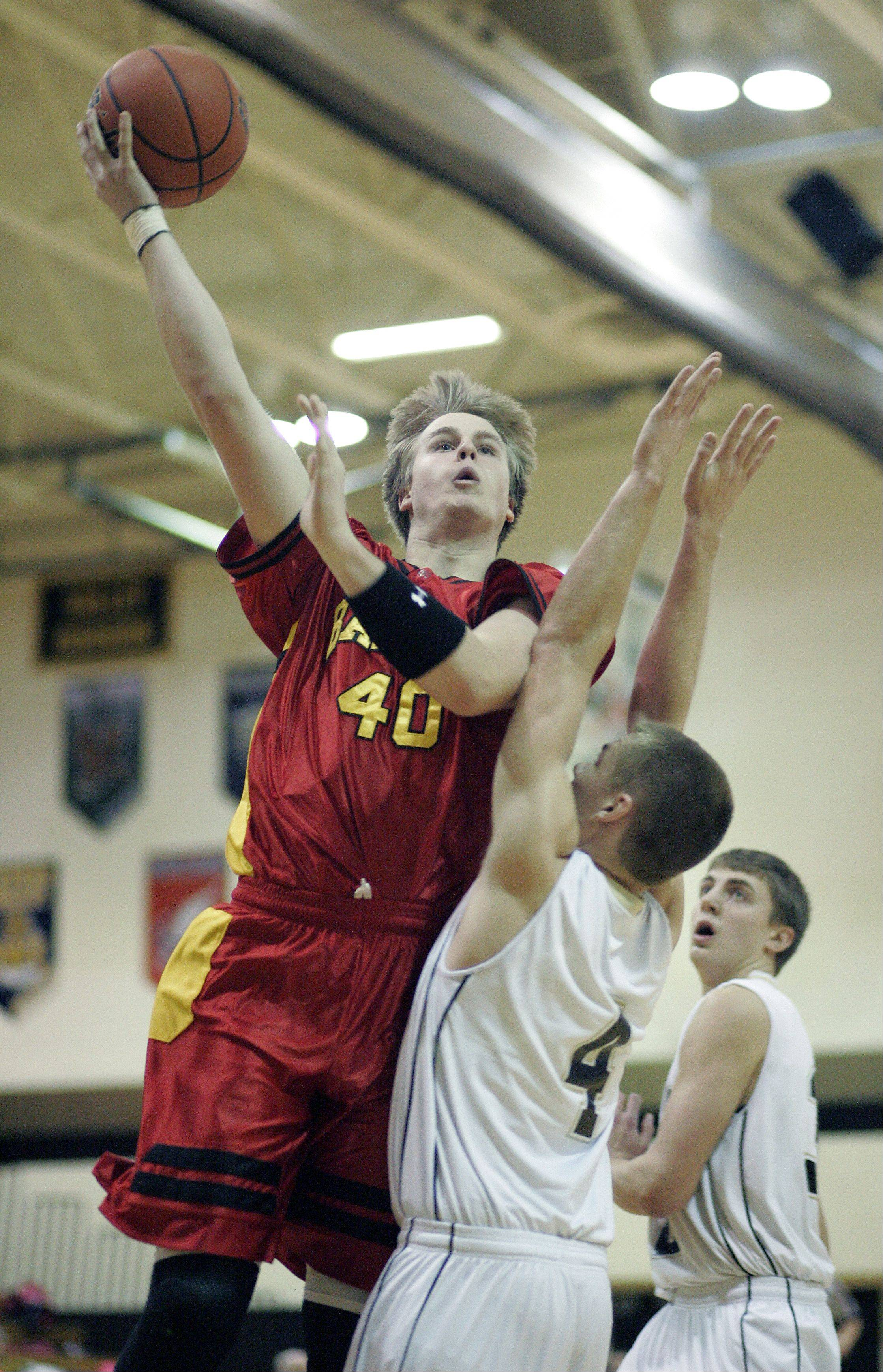 Batavia's Chasen Peez goes to the hoop over Streamwood's Jacob Siewert.
