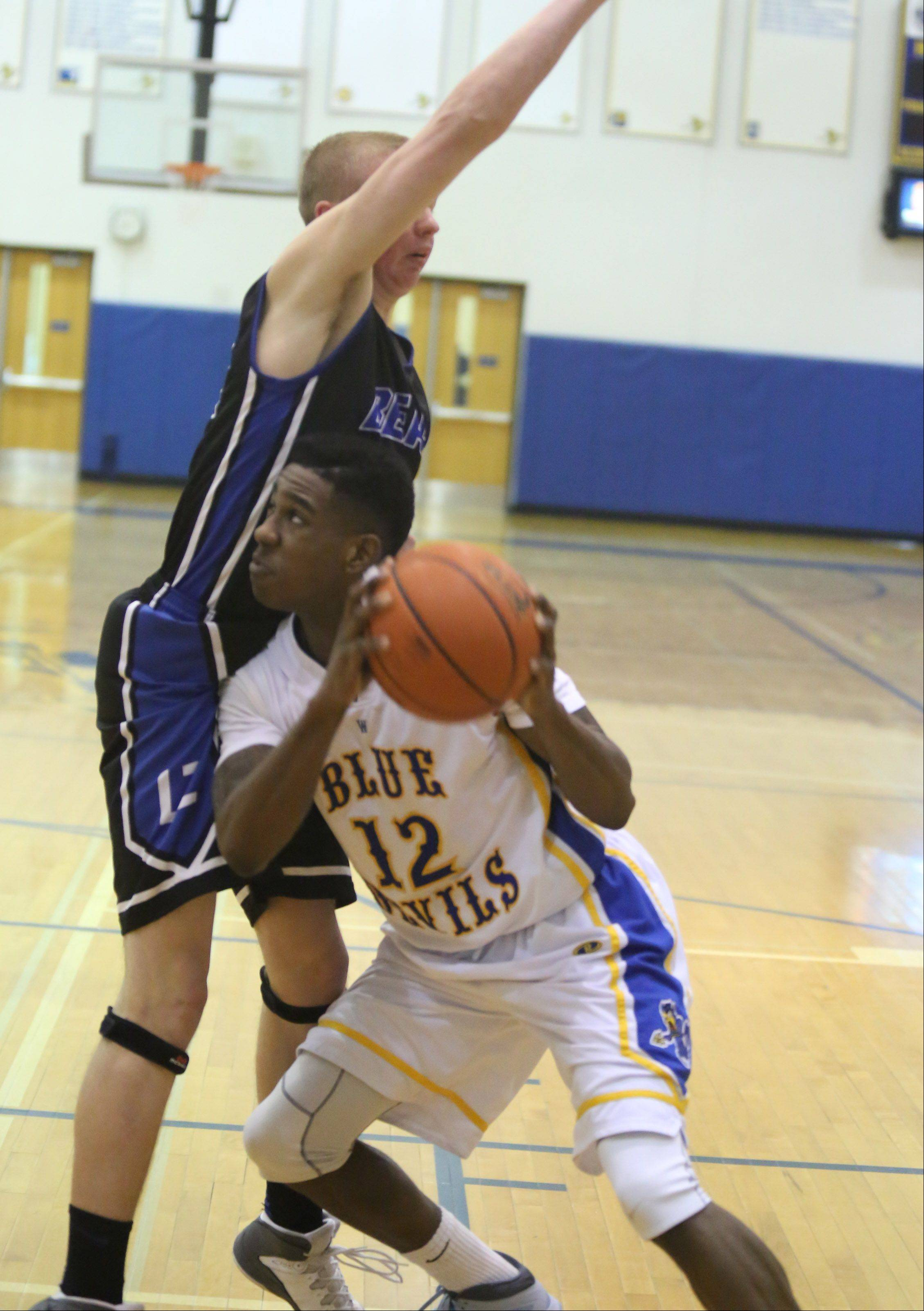 Warren forward Gregory Swane looks to put the ball up against Lake Zurich defender Brad Kruse.