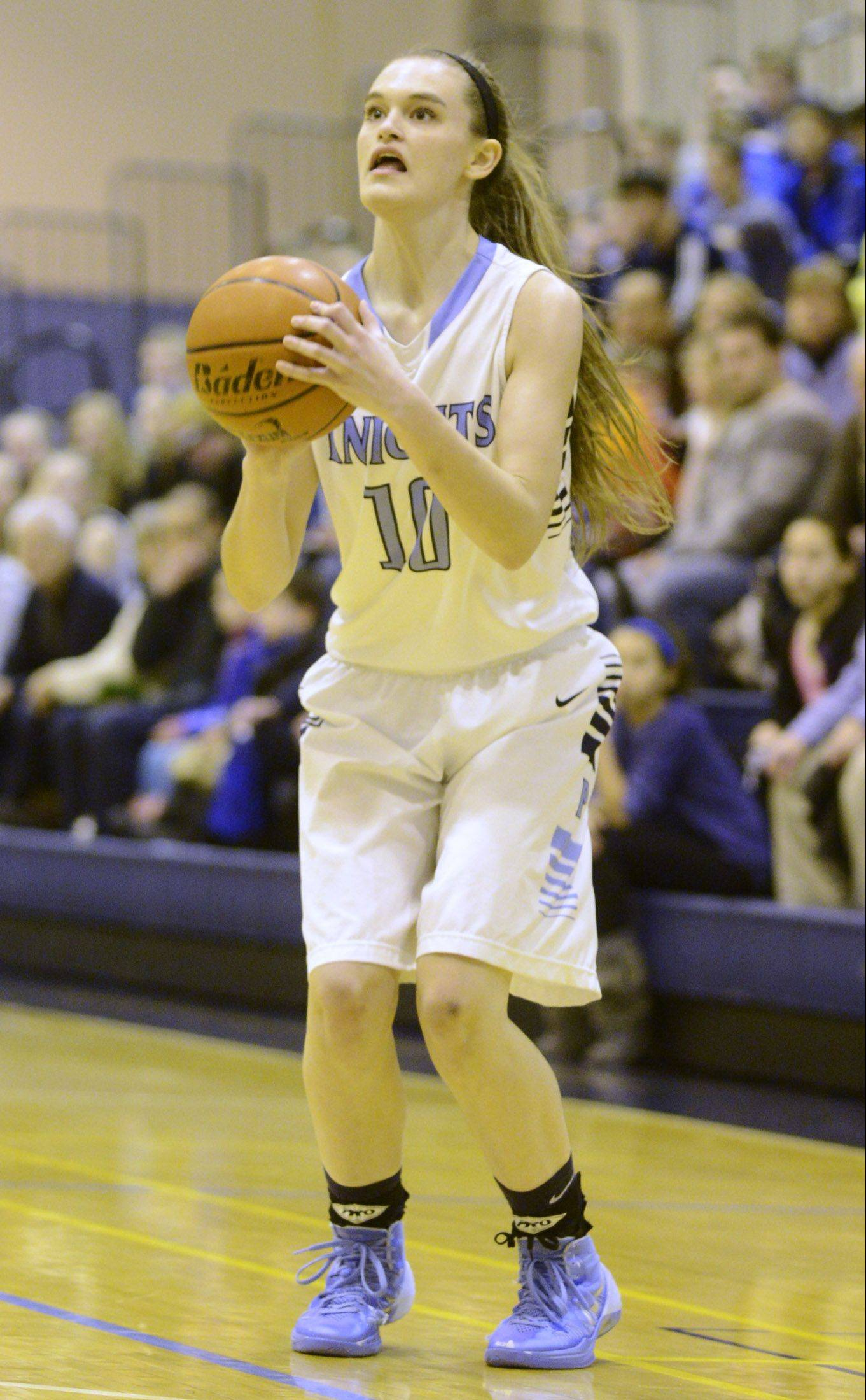 Prospect's Taylor Will surpasses 1,000-career points with a 3-pointer during Saturday's game against Rolling Meadows.