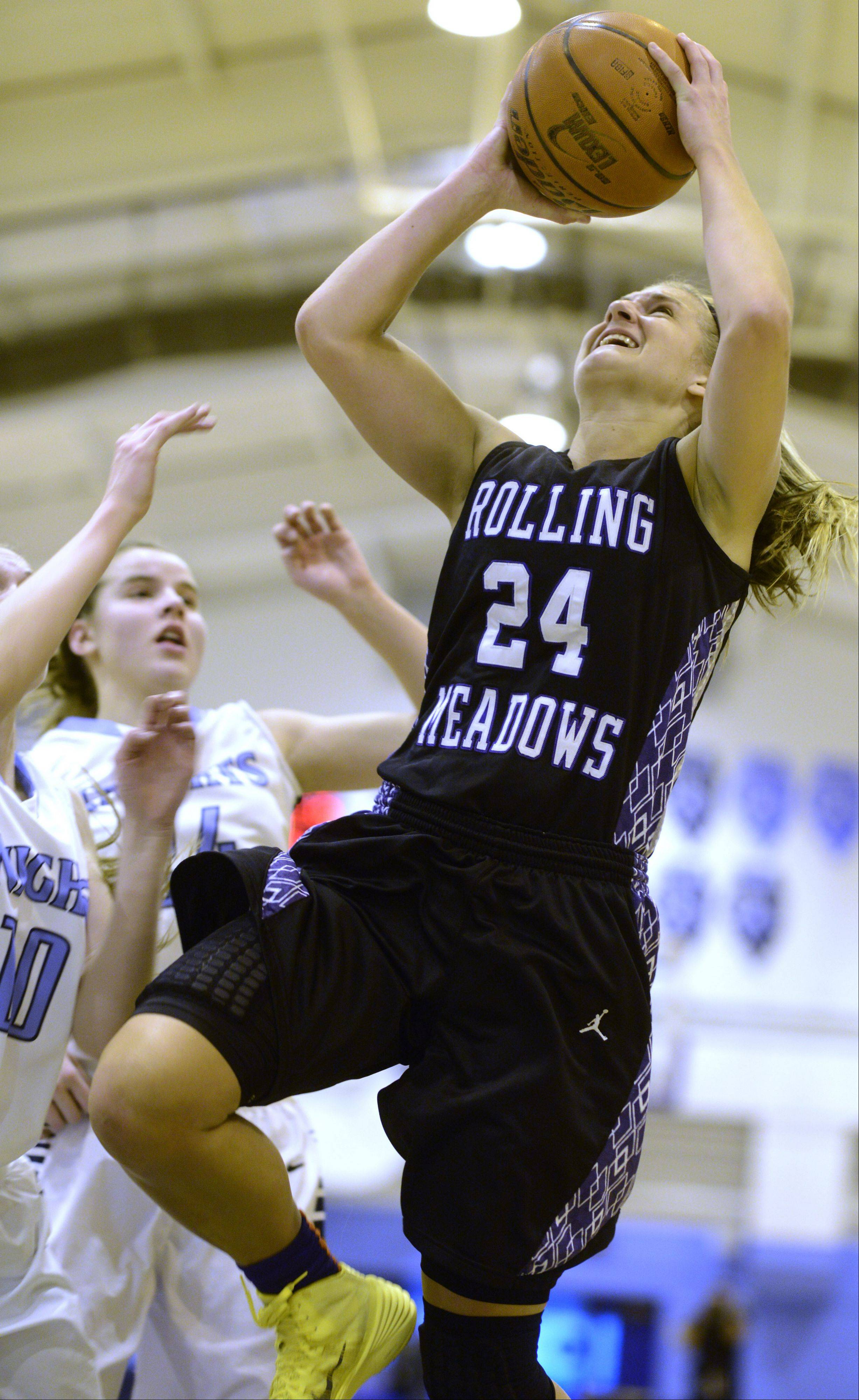 Rolling Meadows' Alexis Glasgow makes a strong move to the basket during Saturday's game against Prospect.