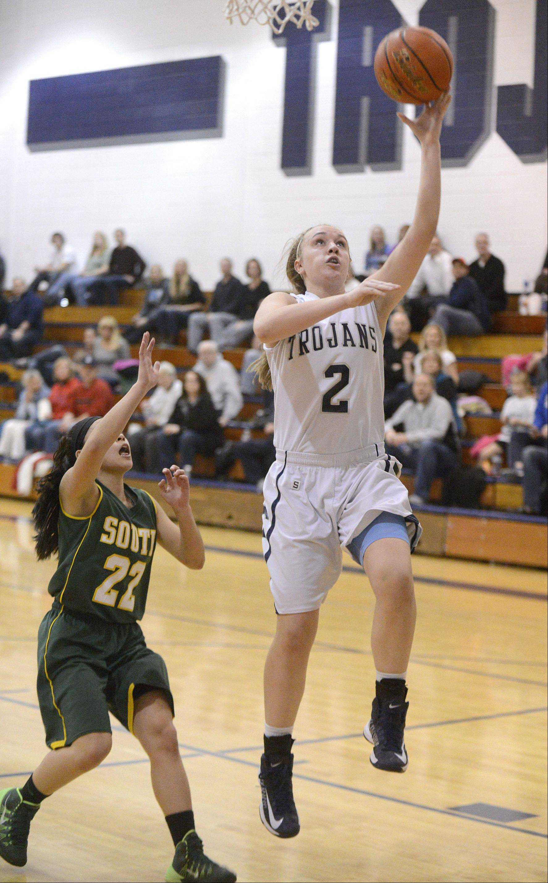 Cary-Grove's Katie Barker sinks a shot over Crystal Lake South's Gabby DeJesus in the third quarter on Saturday.
