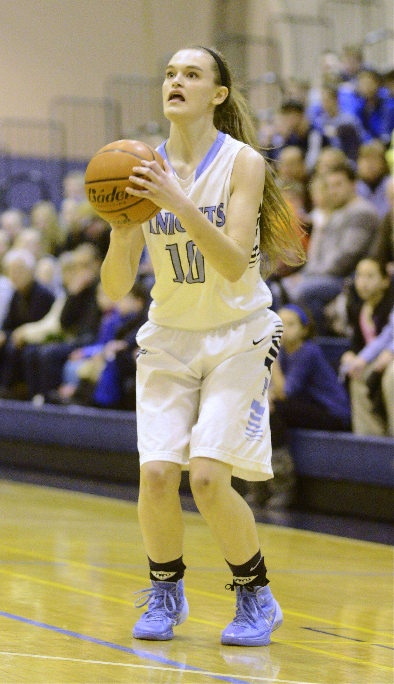 Prospect's Taylor Will surpasses 1,000-career points with a three-pointer during Saturday's game against Rolling Meadows.