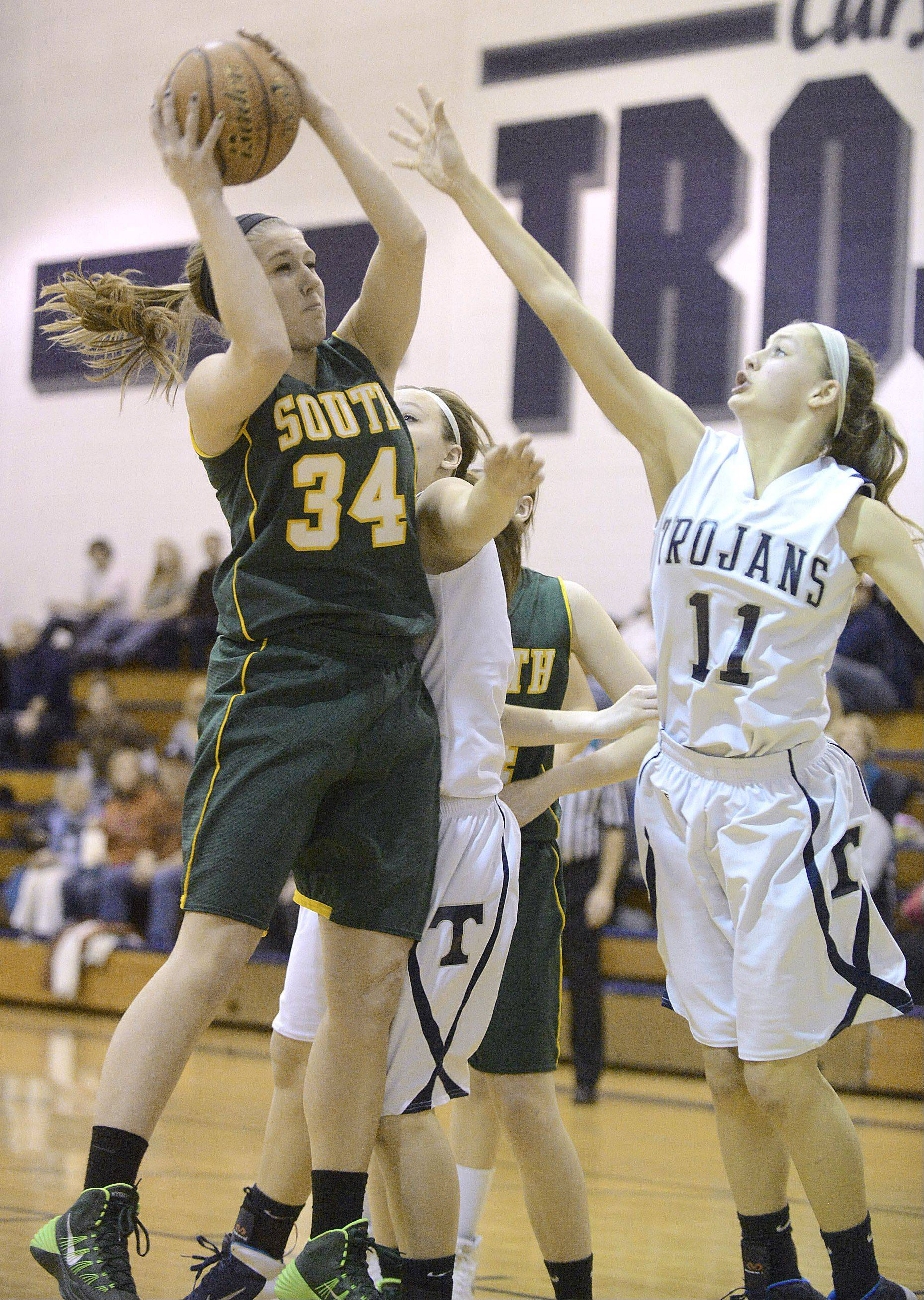 Crystal Lake South's Sara Mickow grabs a rebound before Cary-Grove's Candace Cunningham can grab it in the third quarter on Saturday, January 11.