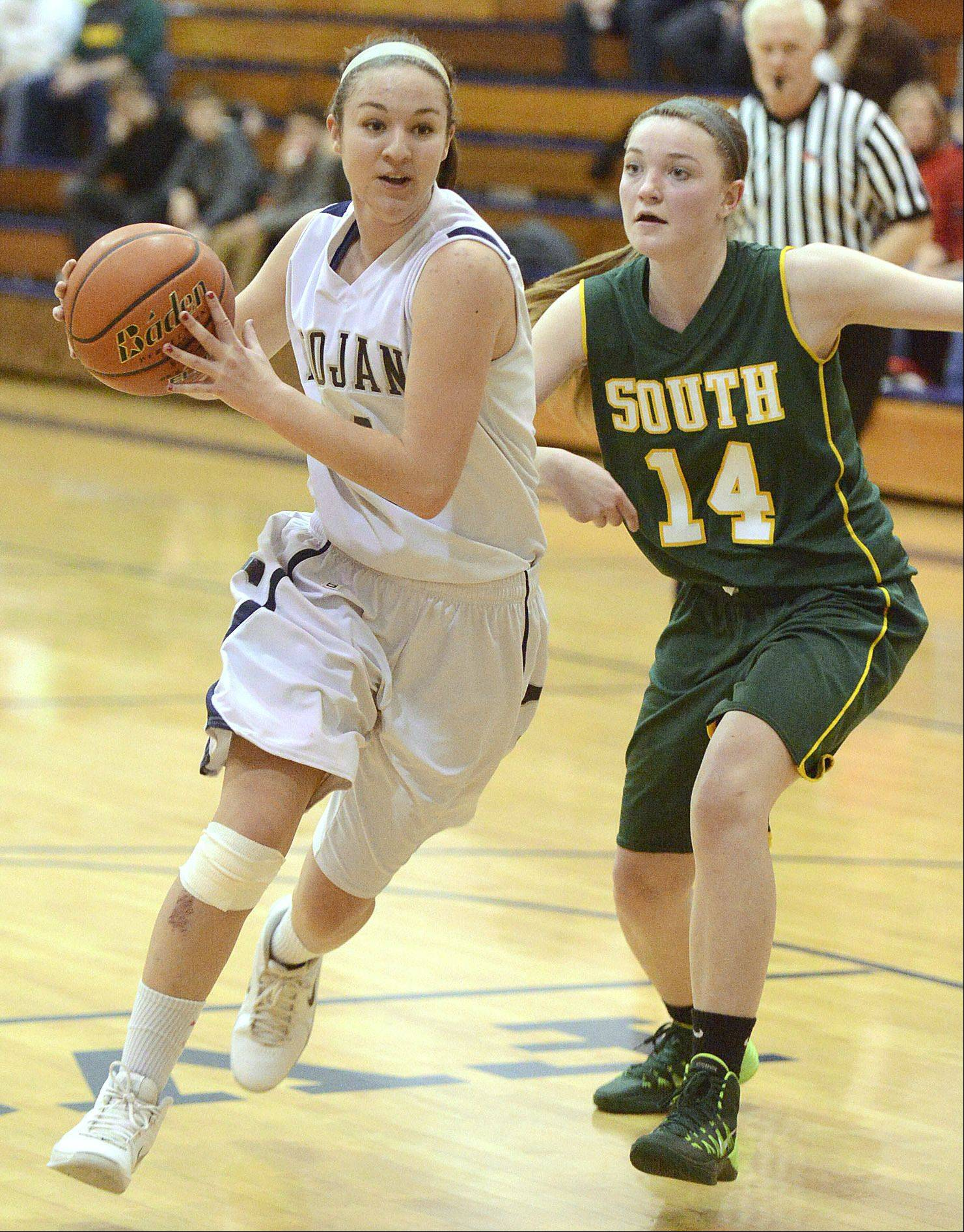 Cary-Grove's Abby Glaysher powers past Crystal Lake South's Chanel Fanter in the third quarter on Saturday, January 11.