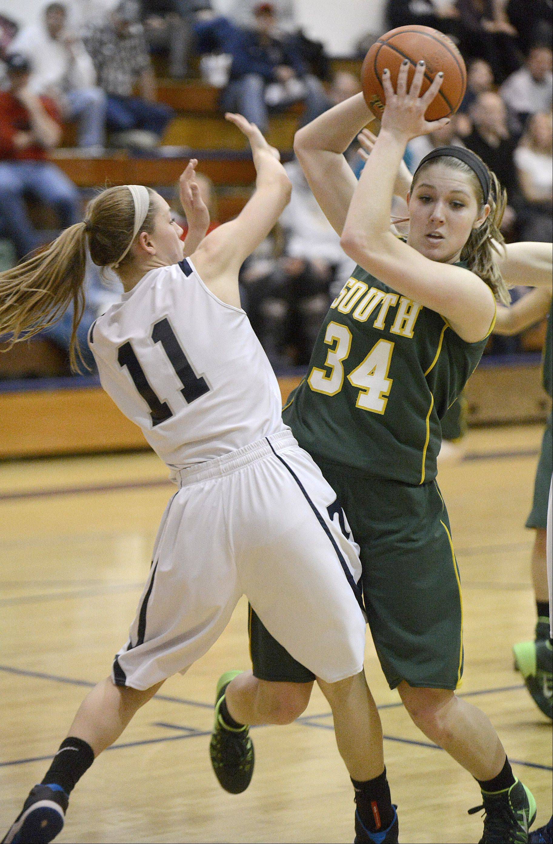 Cary-Grove's Candace Cunningham and Crystal Lake South's Sara Mickow fight for a rebound in the second quarter on Saturday, January 11.